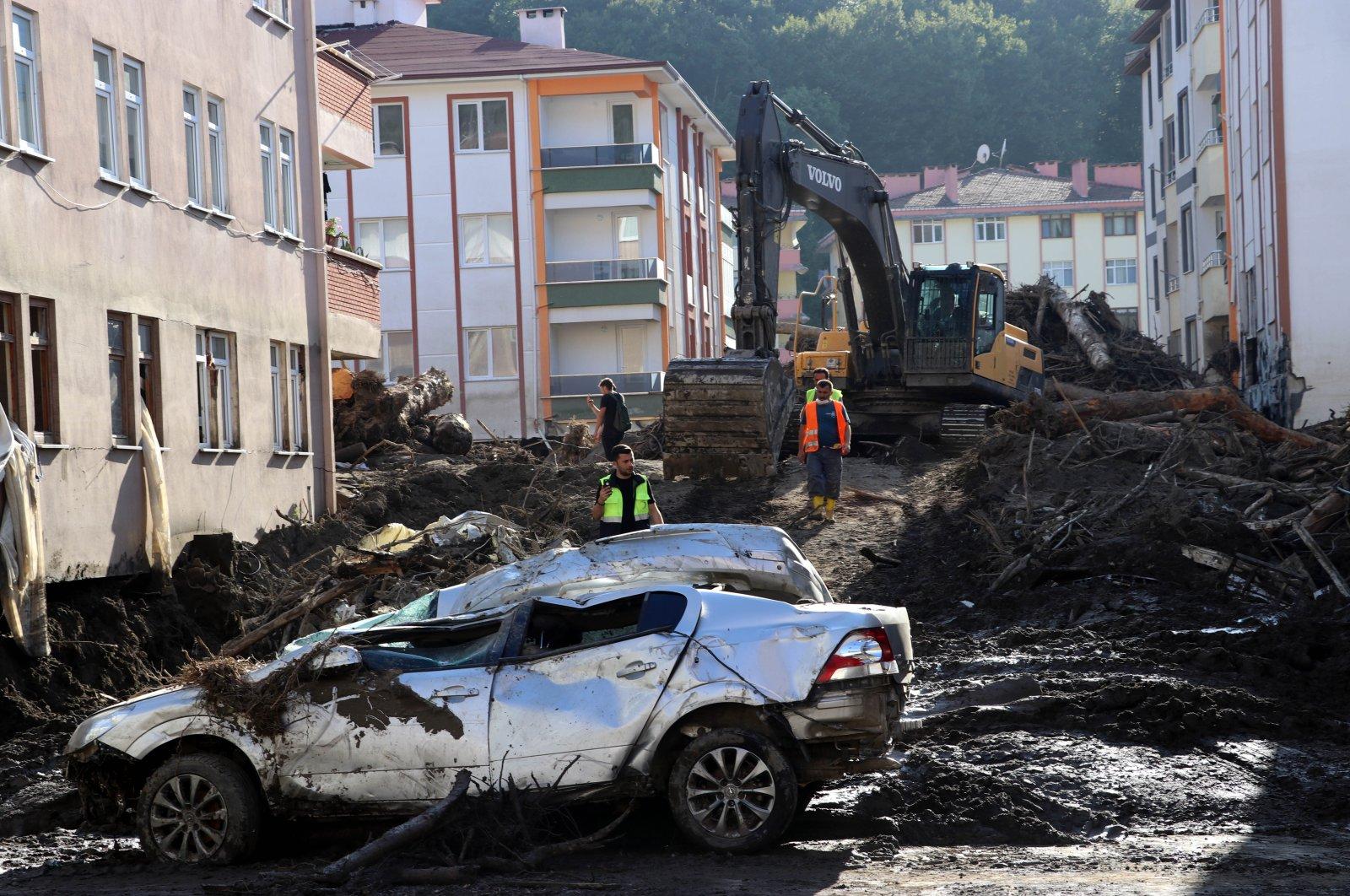 Bulldozers and excavators remove debris from the flood-hit streets, in Bozkurt, in Kastamonu, northern Turkey, Aug. 17, 2021. (AA PHOTO)