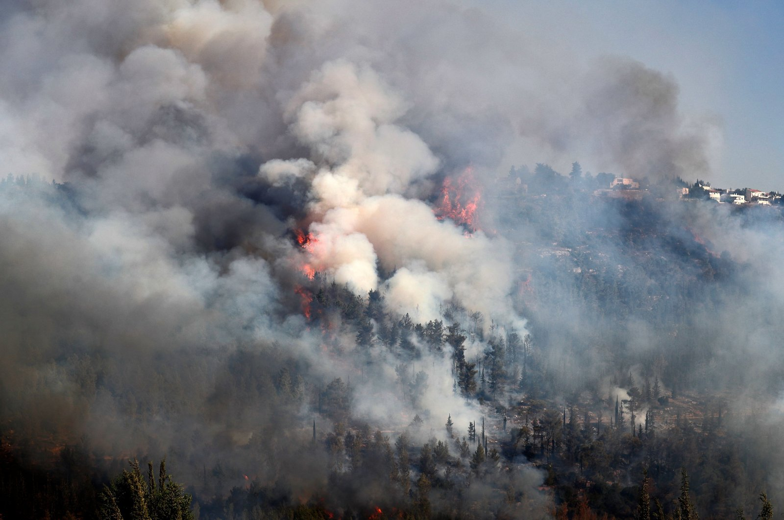 Smoke billows from a forest fire at the Jerusalem mountains near the village of Moshav Shoresh, Israel, Aug. 16, 2021. (AFP Photo)