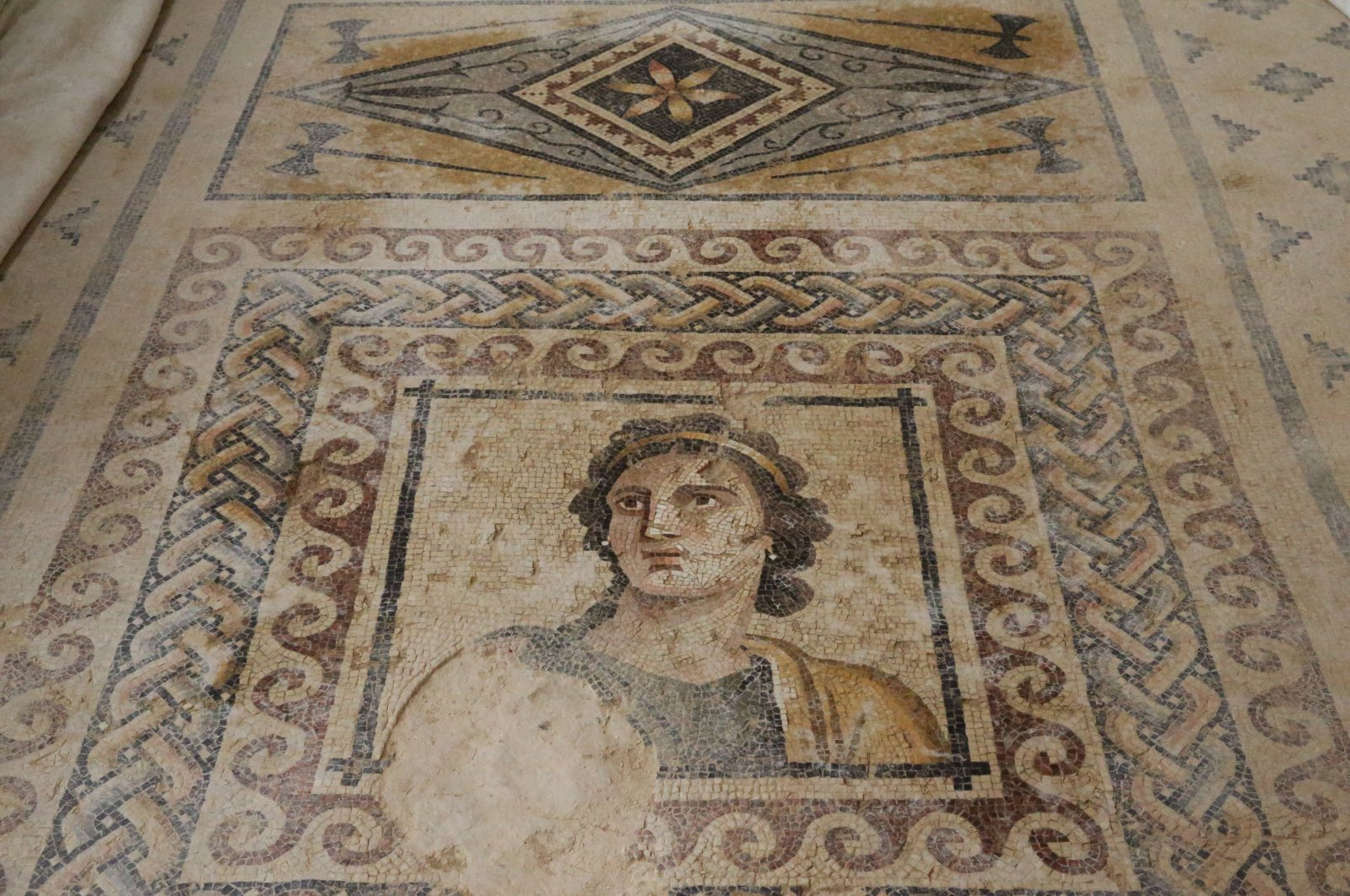 A mosaic of an ancient Greek muse in the House of Muses in the ancient city of Zeugma, Gaziantep, southeastern Turkey, Aug. 17, 2021. (AA Photo)