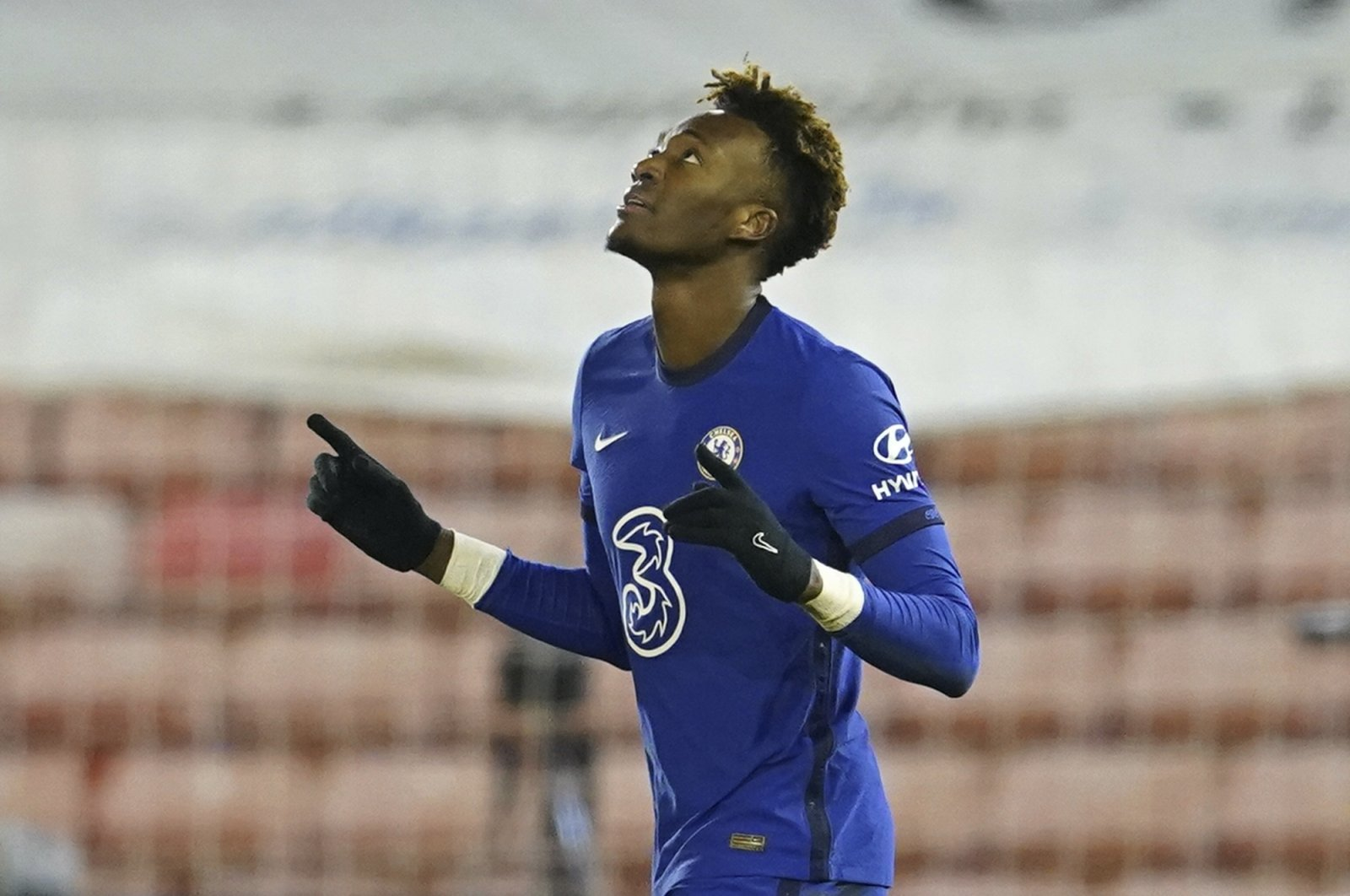 Chelsea's Tammy Abraham celebrates after scoring his side's opening goal during the English FA Cup fifth round soccer match between Barnsley and Chelsea at the Oakwell Stadium in Barnsley, England,Thursday Feb. 11, 2021. (AP Photo/Dave Thompson, Pool)