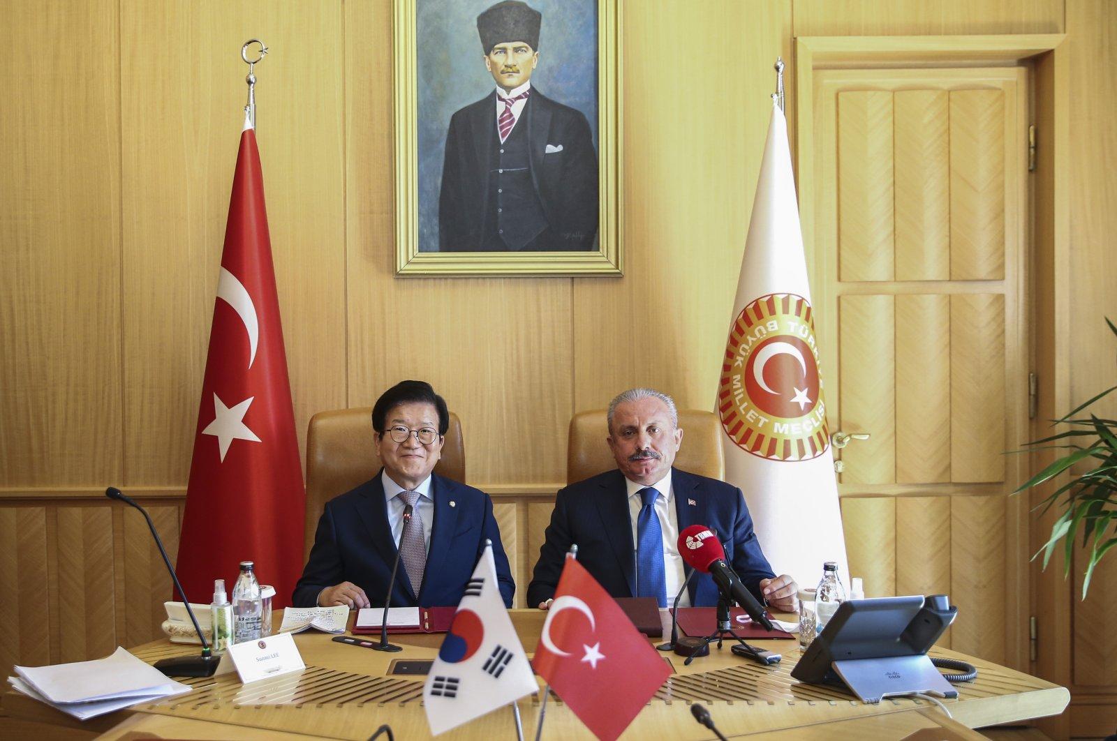Turkey's Parliament Speaker Mustafa Şentop (R) receives South Korean ParliamentSpeaker Park Byeong-seug in the parliament in the capital Ankara, Turkey, Aug. 17, 2021. (AA Photo)