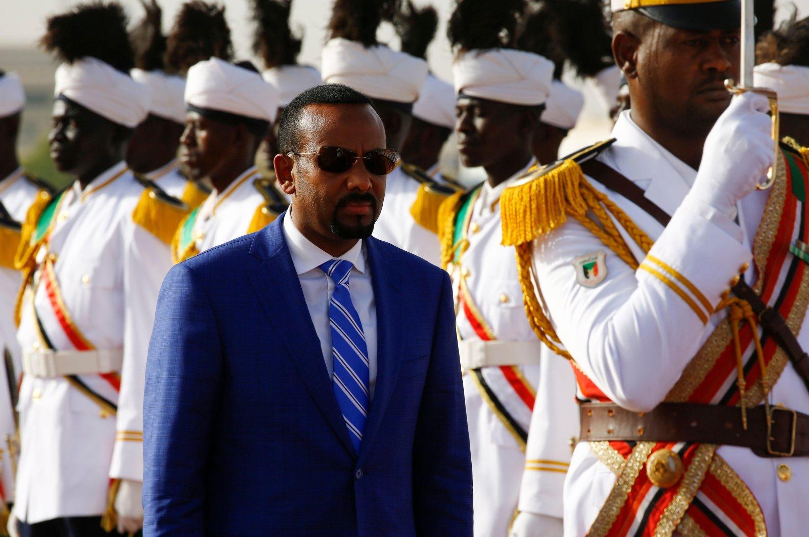 Ethiopian Prime Minister Abiy Ahmed reviews the honour guard following his arrival in Khartoum, Sudan, May 2, 2018. (AFP Photo)