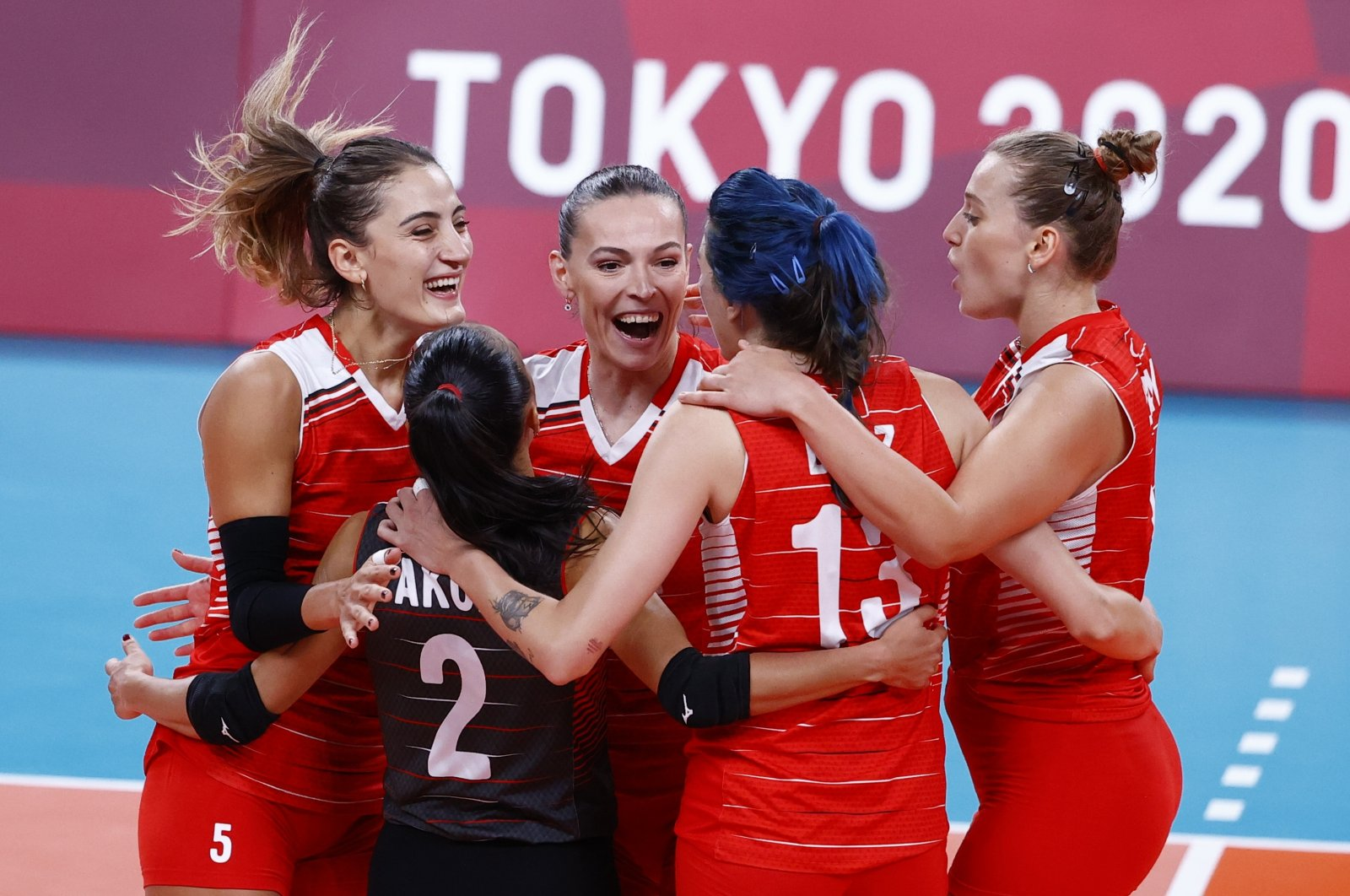 Turkey women's volleyball team players celebrate during their Tokyo 2020 Olympics women's quarterfinal games at Ariake Arena, Tokyo, Japan, Aug. 4, 2021. (Reuters Photo)