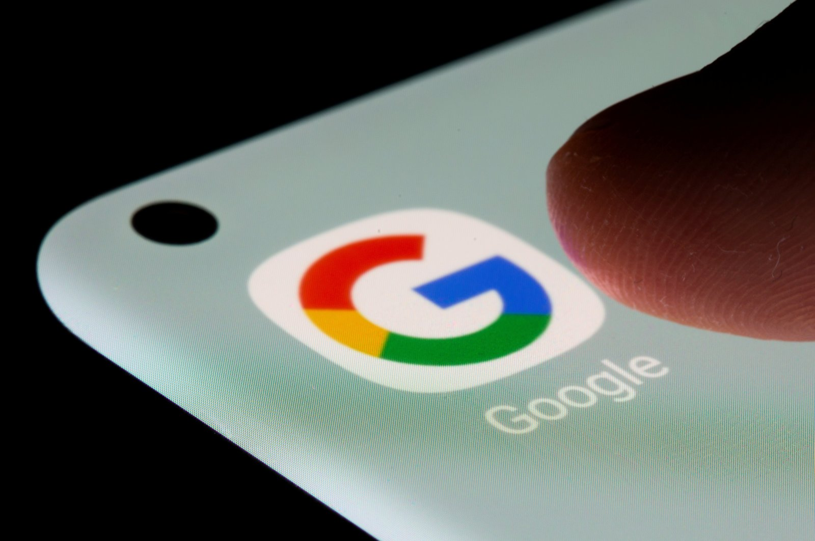 The Google logo is seen on a smartphone in this illustration taken July 13, 2021. (Reuters File Photo)