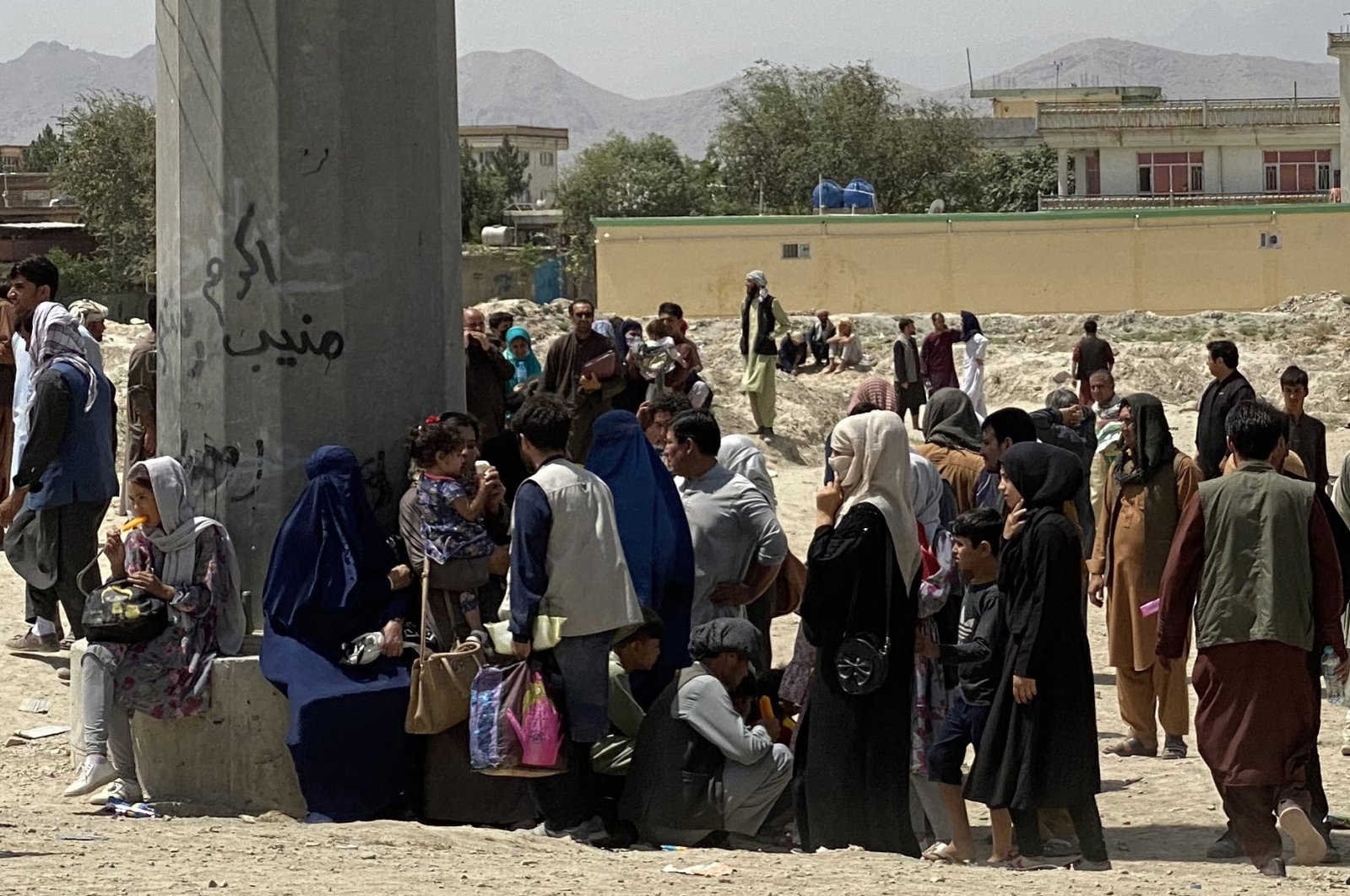 Afghans gather outside the Hamid Karzai International Airport to flee the country, after Taliban took control of Kabul, Afghanistan, Aug. 17, 2021. (EPA Photo)