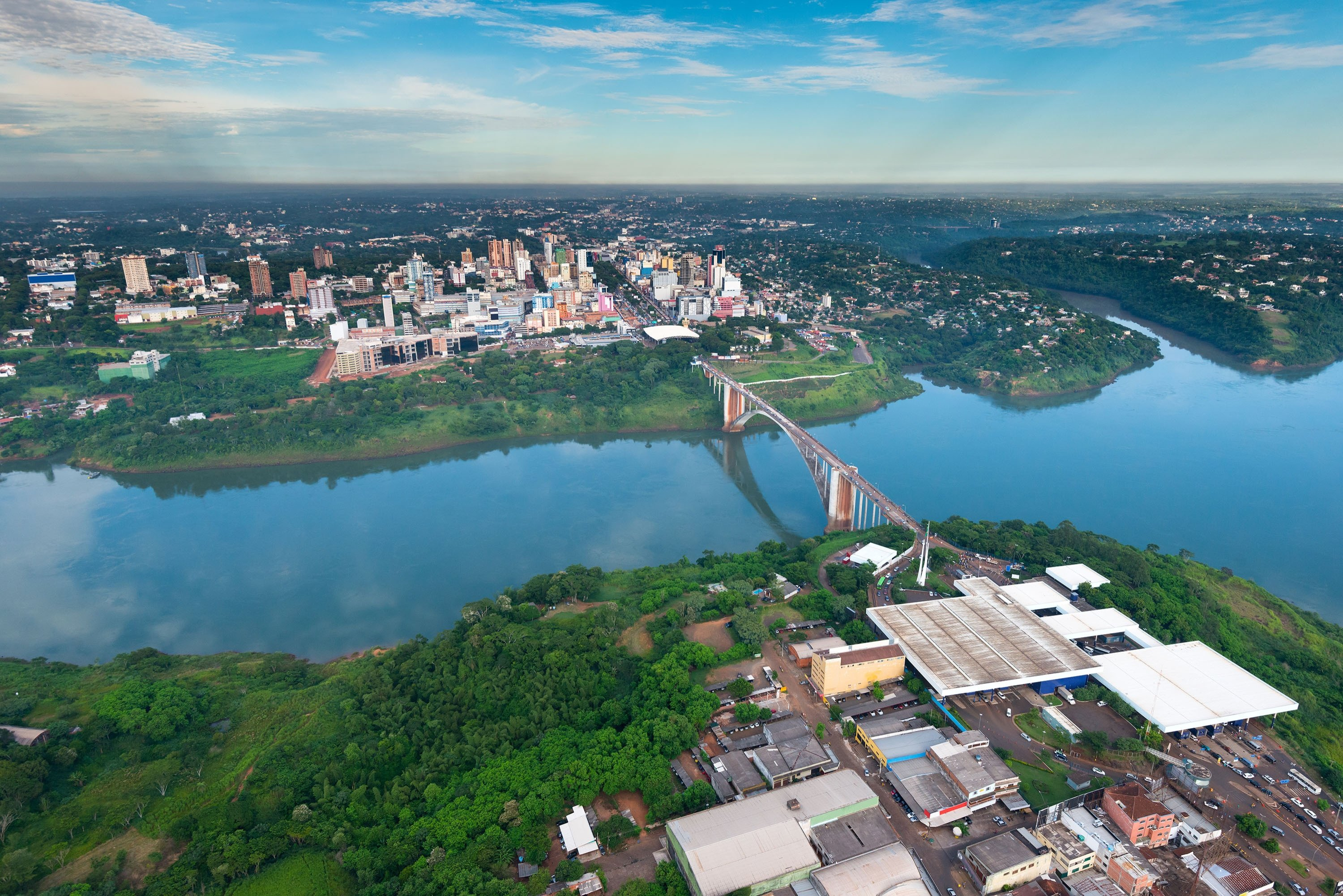 An aerial view of the Paraguayan city of Ciudad del Este and Friendship Bridge, connecting Paraguay and Brazil through the border over the Parana River. (Shutterstock Photo)