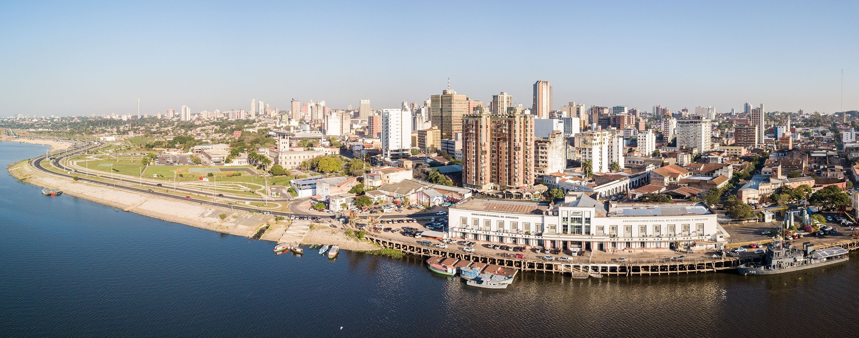 A panoramic view of skyscrapers in the Latin American capital of Ciudad de Asuncion, Paraguay, and the embankment of Paraguay river as seen in an aerial drone photo, July 13, 2018. (Shutterstock Photo)