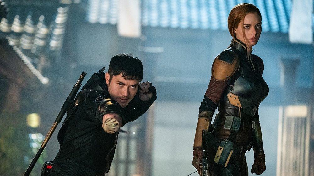 Samara Weaving (R) as Scarlett and Henry Golding as Snake Eyes in 'Snake Eyes.'