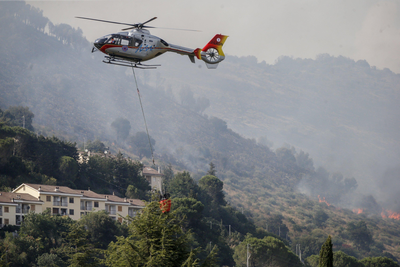 Emergency staff fights a fire on Castillo mountain park near Tivoli a few miles from Rome, Italy, Aug. 13, 2021. (Cecilia Fabiano/LaPresse via AP)