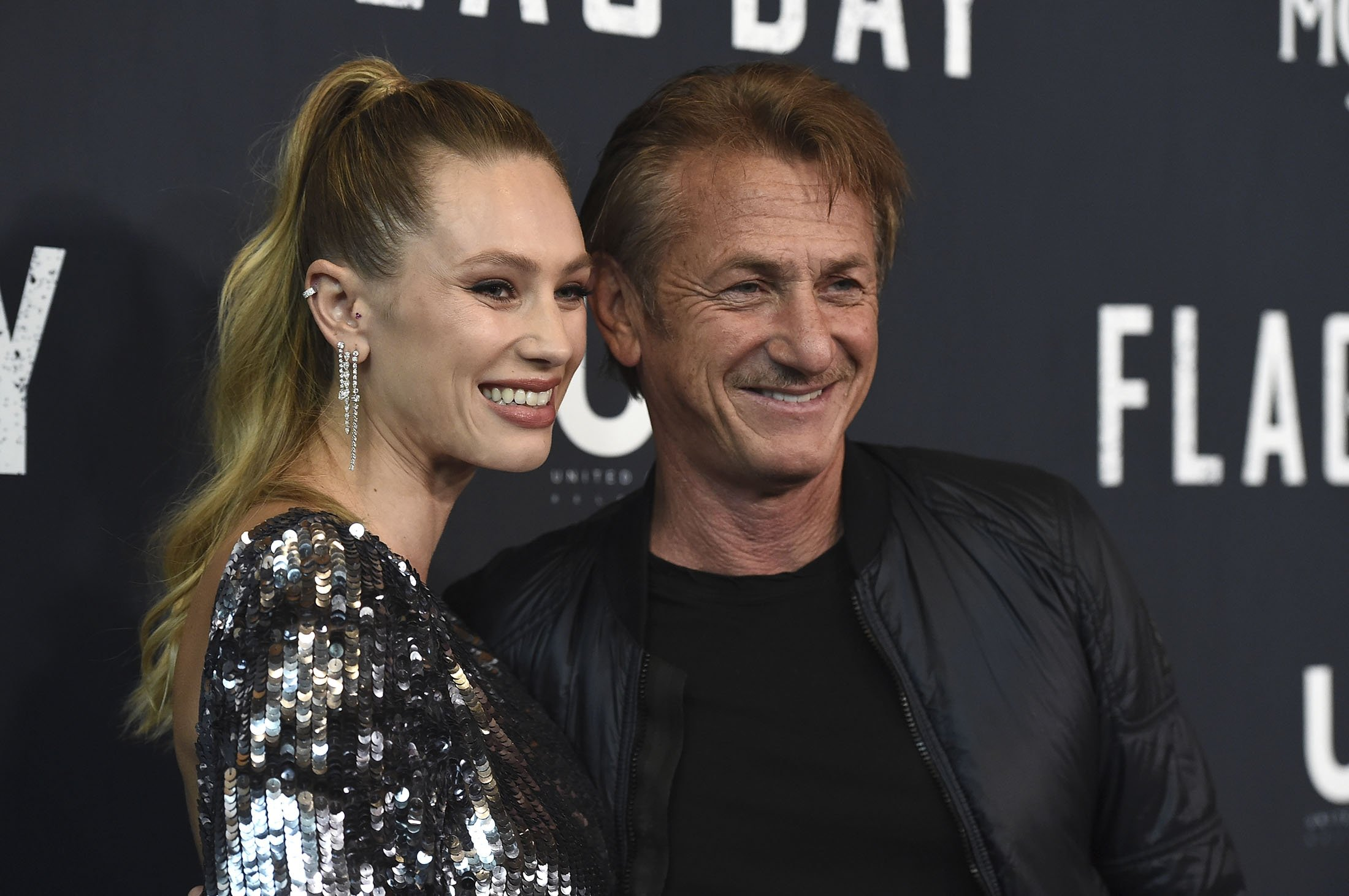 Dylan Penn (L), and her father, Sean Penn, who plays her father in the movie as well, arrive at the Los Angeles premiere of 'Flag Day' at the Directors Guild of America Theater, in Los Angeles, U.S., Aug. 11, 2021. (AP Photo)