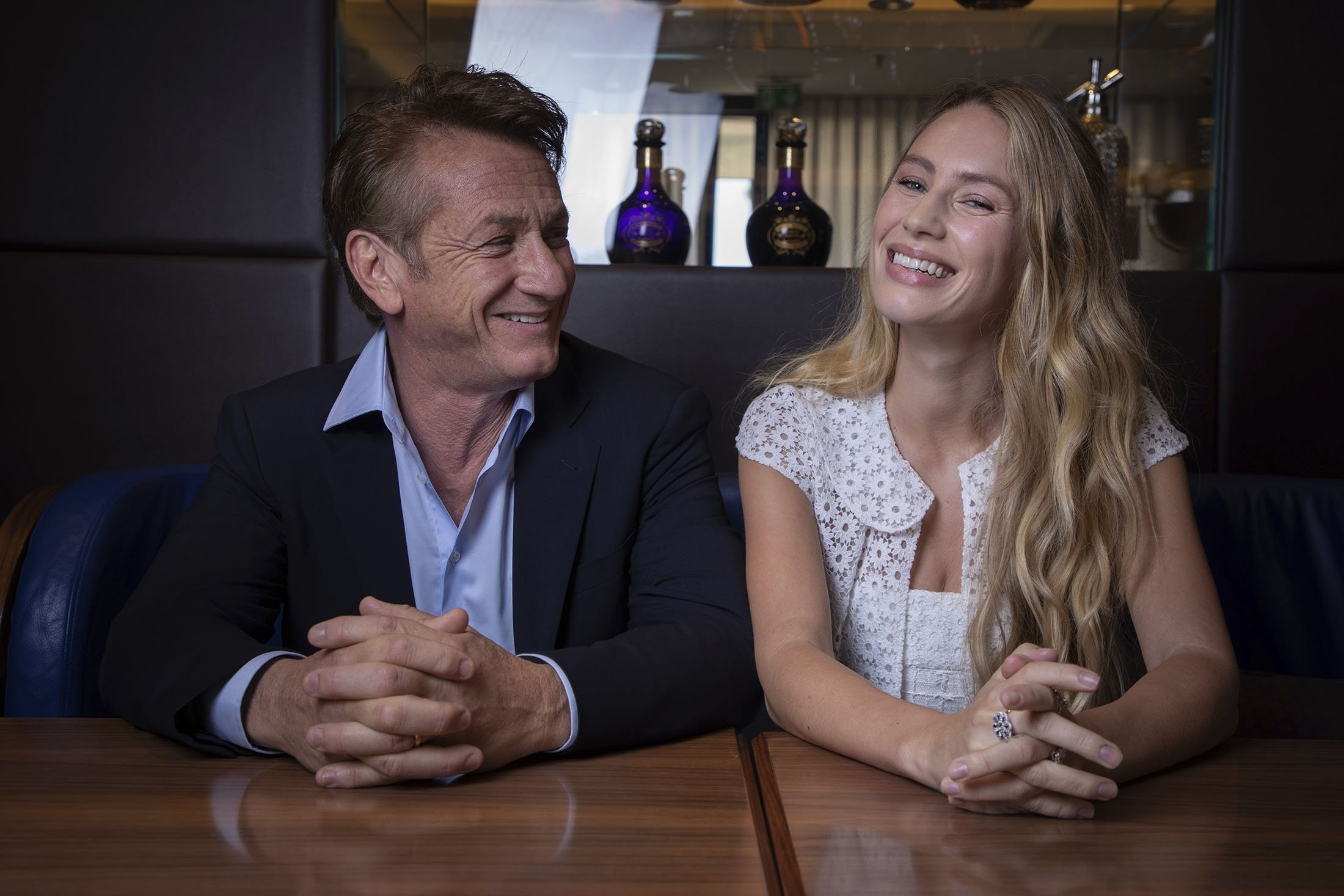 Sean Penn (L), and Dylan Penn pose for portrait photographs for the film 'Flag Day,' at the 74th international film festival, Cannes, southern France, July 10, 2021. (AP Photo)