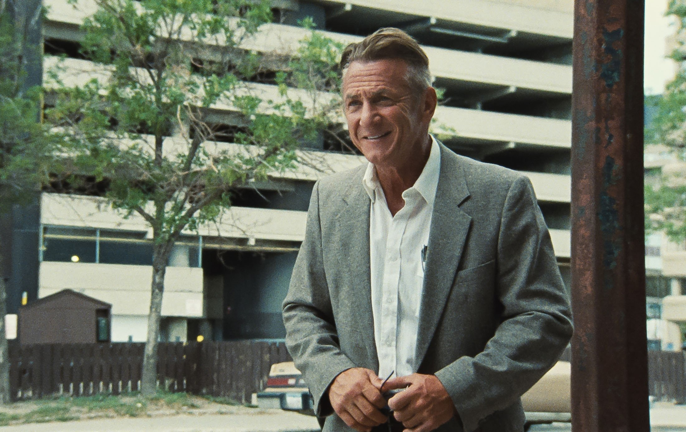 Sean Penn smiles, in a scene from the film 'Flag Day.' (MGM via AP)