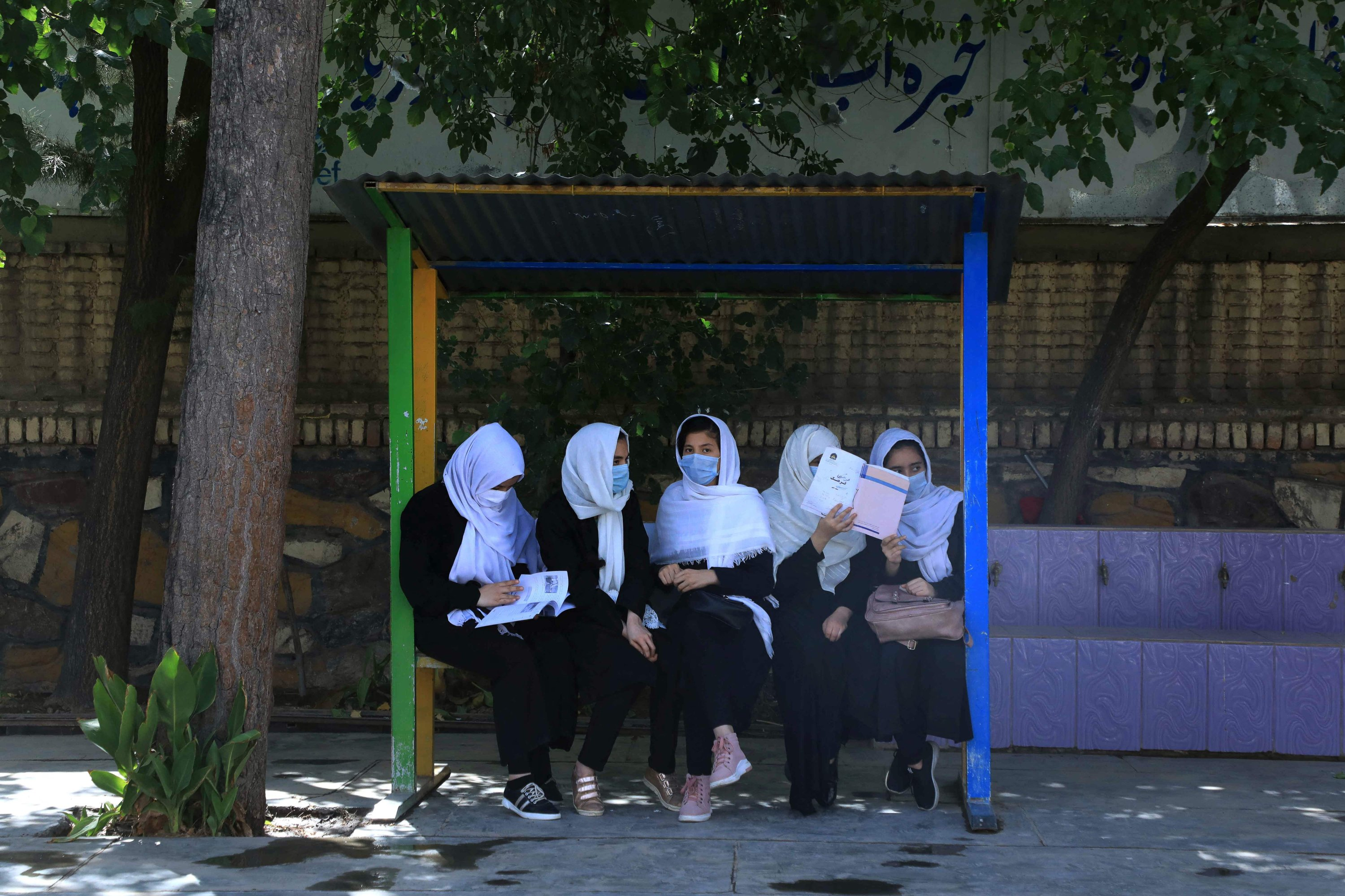 Schoolgirls sit in a schoolyard in Herat, Afghanistan, Aug. 17, 2021, following the Taliban's stunning takeover of the country. (AFP Photo)