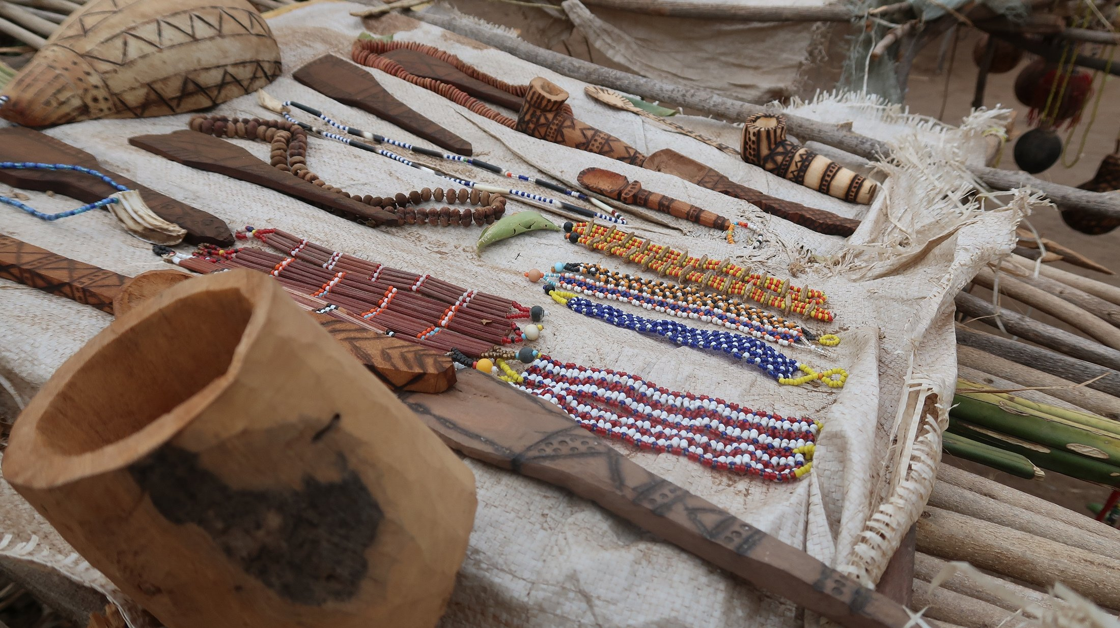 Souvenirs made by the Hadza people can be seen on a table in Tanzania. (Shutterstock Photo)