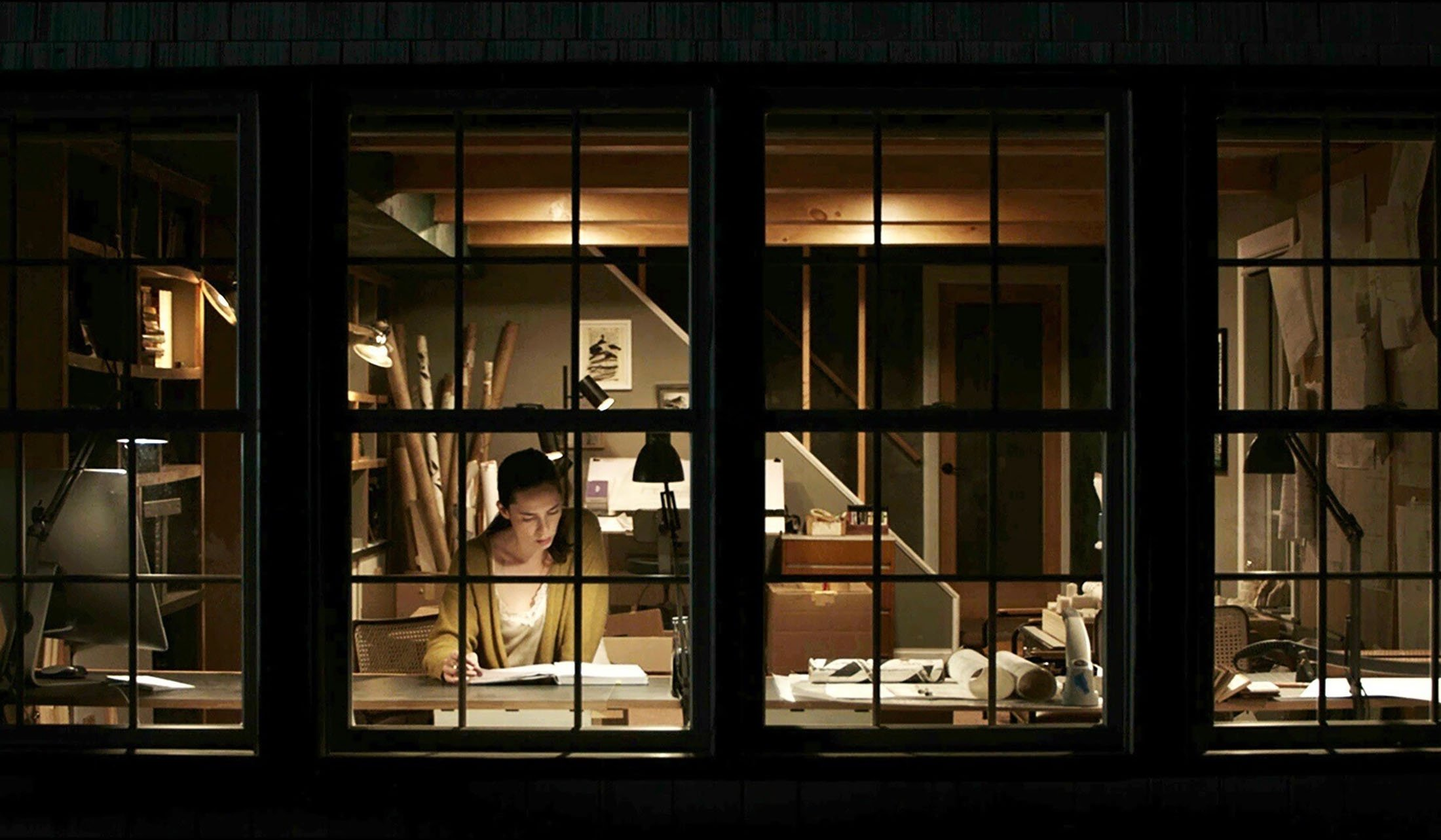 Rebecca Hall reads a book, in a scene from the film 'The Night House.'(Searchlight Pictures via AP)