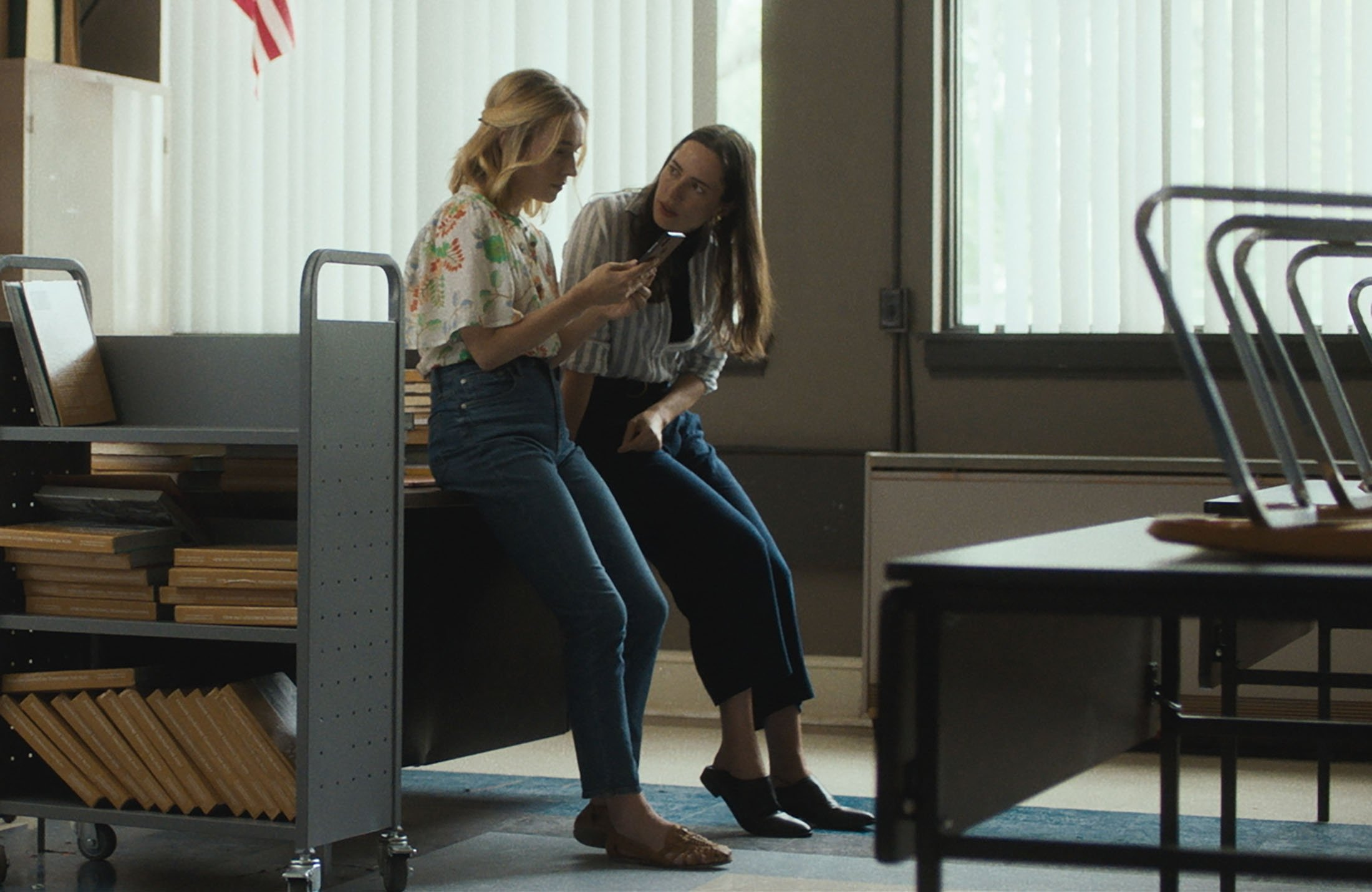Sarah Goldberg (L), and Rebecca Hall talk, in a scene from the film 'The Night House.'(Searchlight Pictures via AP)