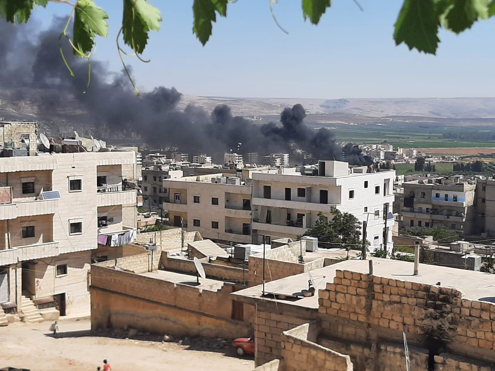 The PKK terrorist group's Syrian branch, the YPG, attacked Afrin city center, northern Syria, Aug. 18, 2021. (DHA Photo)