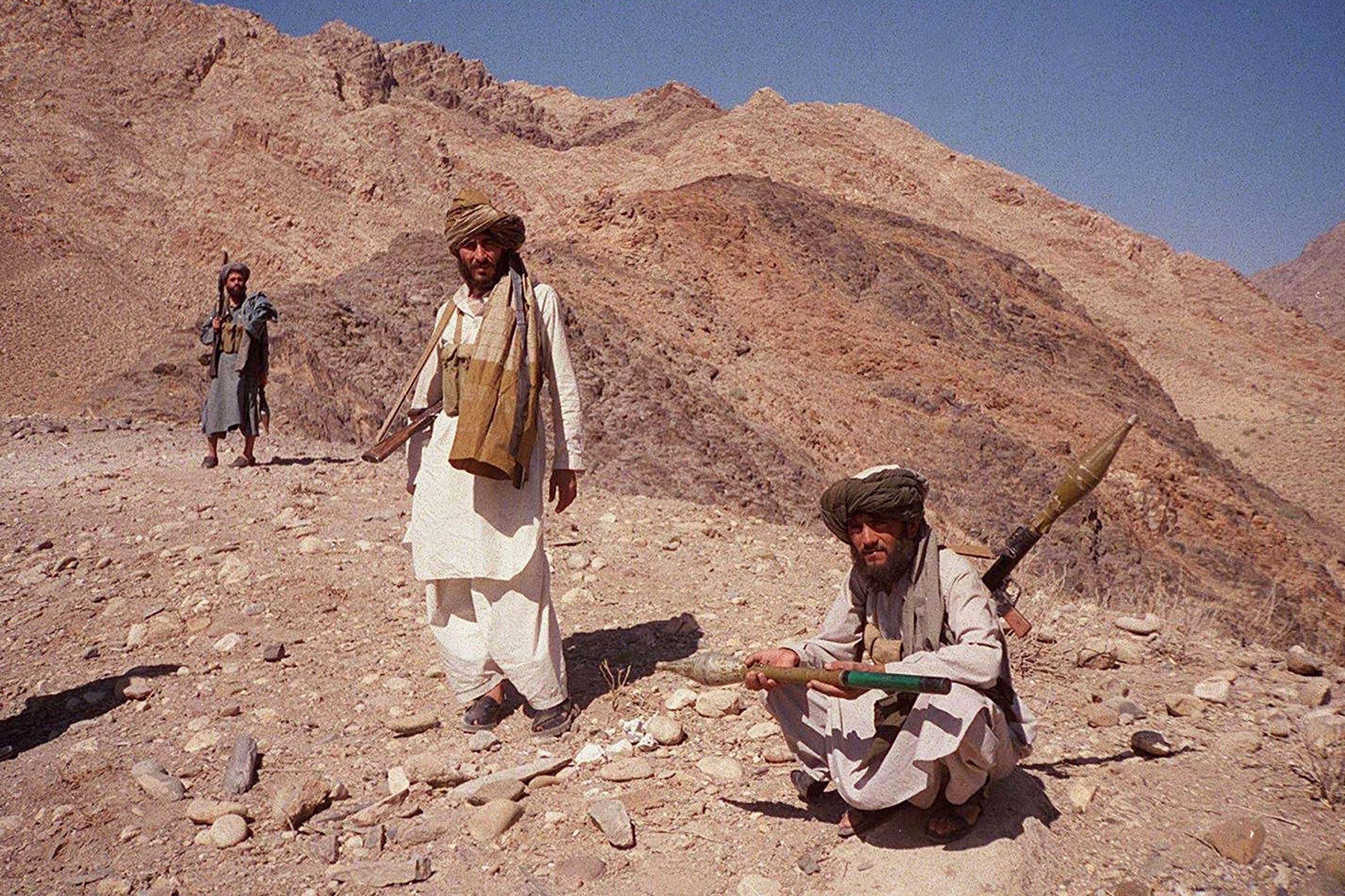 Taliban fighters posing on a hilltop near Jalalabad, Afghanistan on Oct. 14, 2001. (AFP Photo)