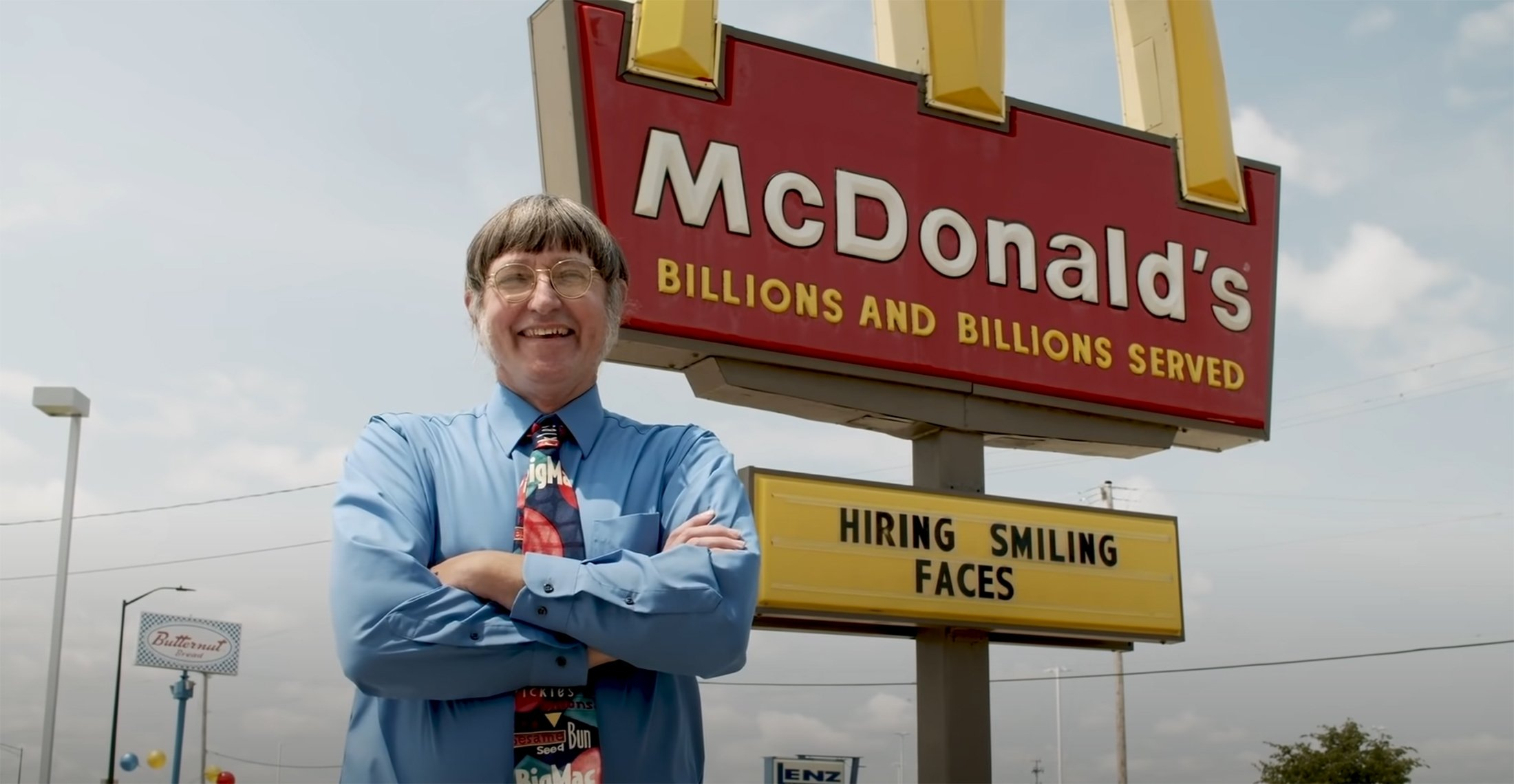 Donald Gorske smiles in front of McDonald's golden arches logo in this still image from a video on Guinness World Records' official YouTube channel. (Guinness World Records via YouTube)