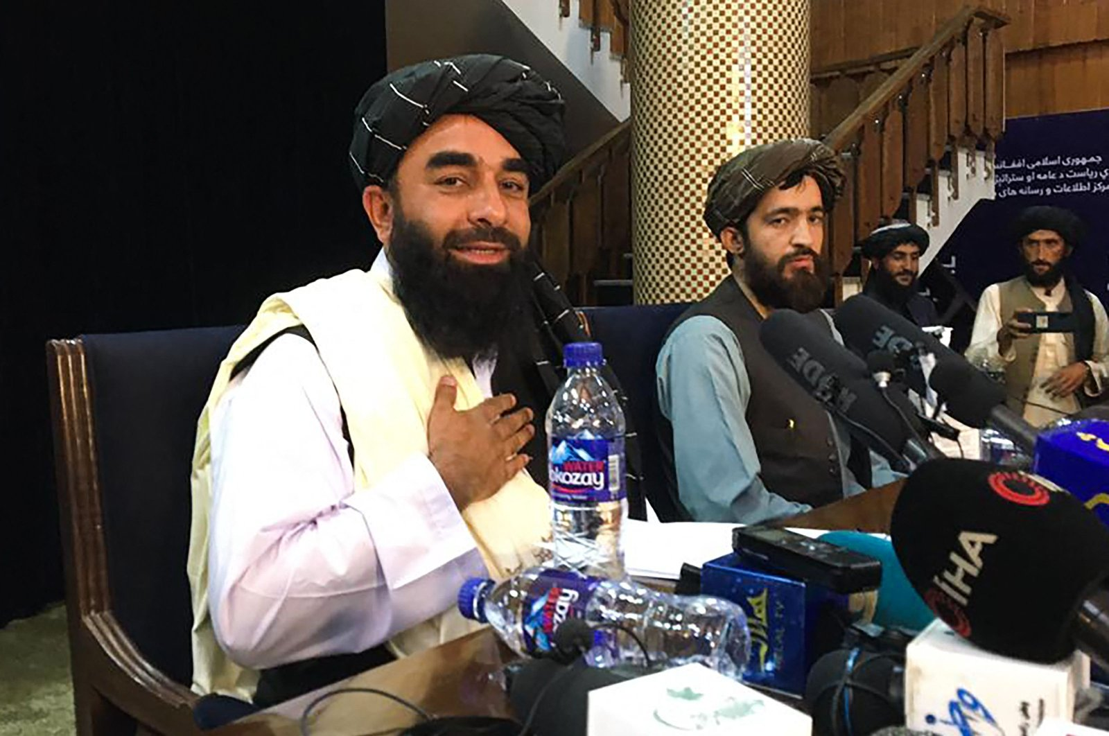Taliban spokesperson Zabihullah Mujahid (L) attends the first press conference following their stunning takeover of Afghanistan in Kabul, Afghanistan, on Aug. 17, 2021. (AFP Photo)