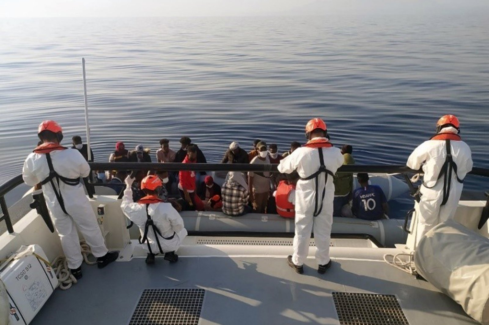 A total of 61 asylum-seekers pushed back by Greece were rescued off İzmir province's Dikili district, Turkey, Aug. 2, 2021 (AA Photo)