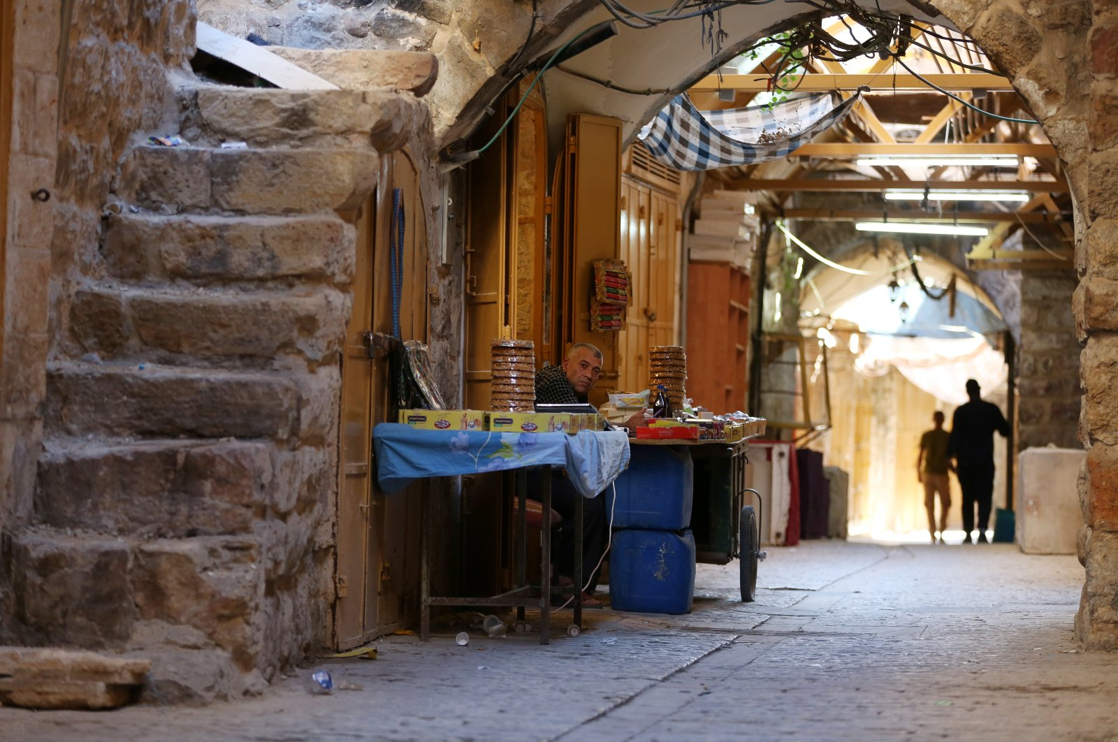 A view of people in one of the narrow streets in the Old City of Hebron in the West Bank, Palestine, Aug. 14, 2021. (EPA Photo)