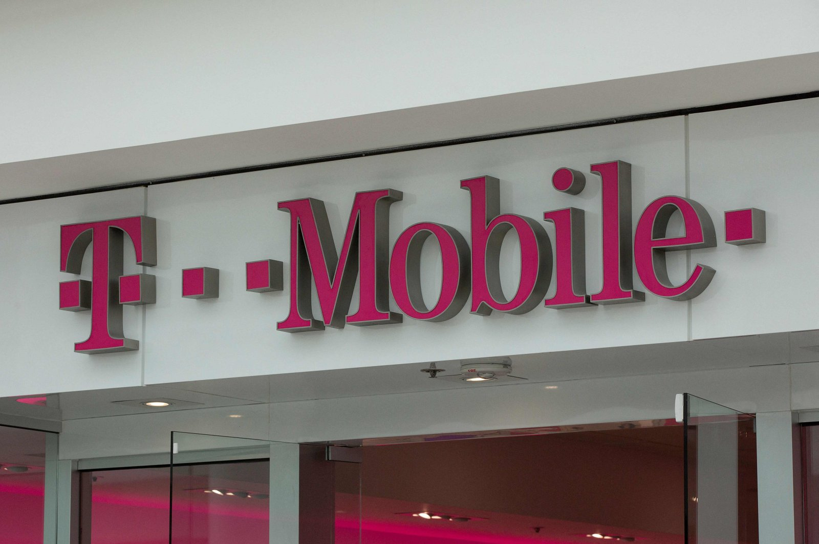 The T-Mobile logo is seen outside a shop in Washington, D.C., on July 26, 2019. (AFP Photo)