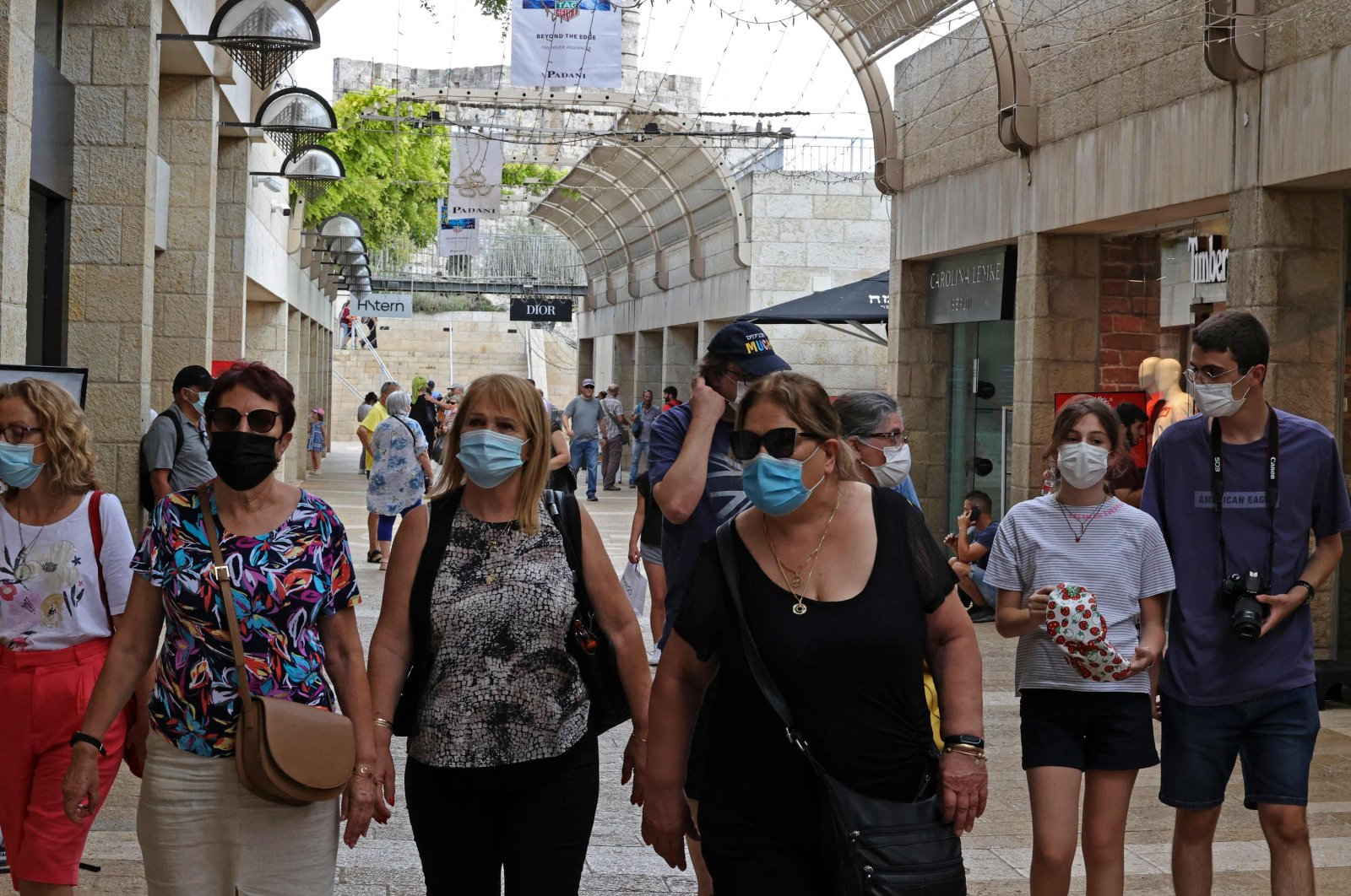 People wear masks against the coronavirus as they walk at a market in Jerusalem, Israel, Aug. 11, 2021. (AFP Photo)