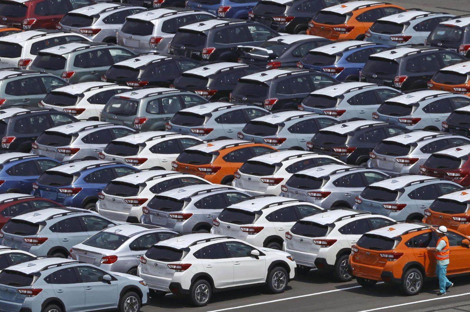 Vehicles wait to be exported at a port in Kawasaki, near Tokyo, Japan, Aug. 2, 2018. (AP Photo)
