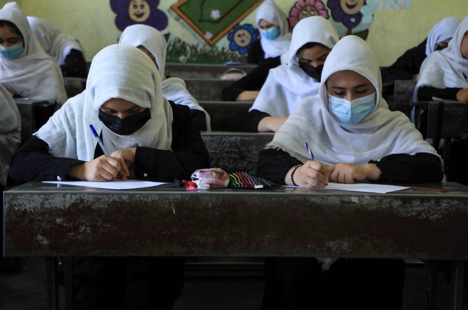 Schoolgirls attend class in Herat, Afghanistan, Aug. 17, 2021, following the Taliban's stunning takeover of the country. (AFP Photo)