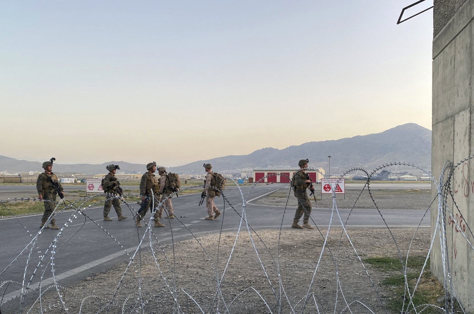 U.S. soldiers stand guard along a perimeter at the international airport in Kabul, Afghanistan, Aug. 16, 2021. (AP Photo)