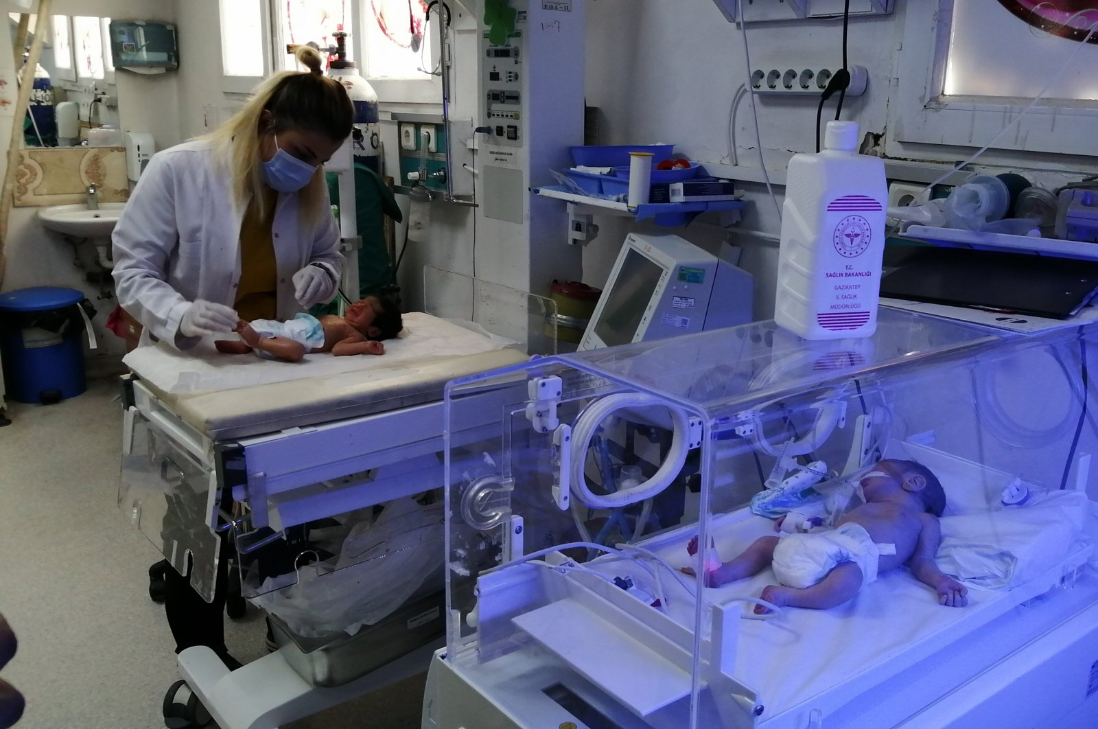 A health care worker attends the newborn babies at the hospital in Jarablus, Syria, Aug. 18, 2021. (AA PHOTO)