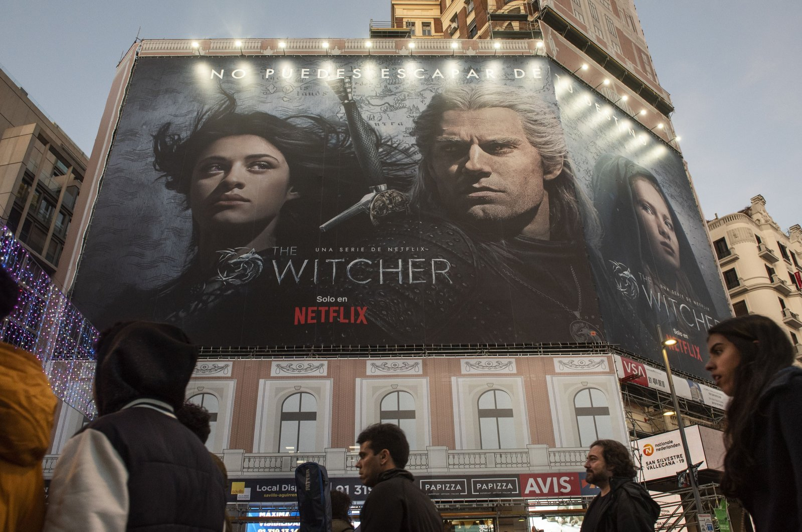 """An advertisement for the streaming Netflix's TV series """"The Witcher,"""" can be seen on the side of a building, in Spain, Jan. 9, 2020. (Getty Images)"""