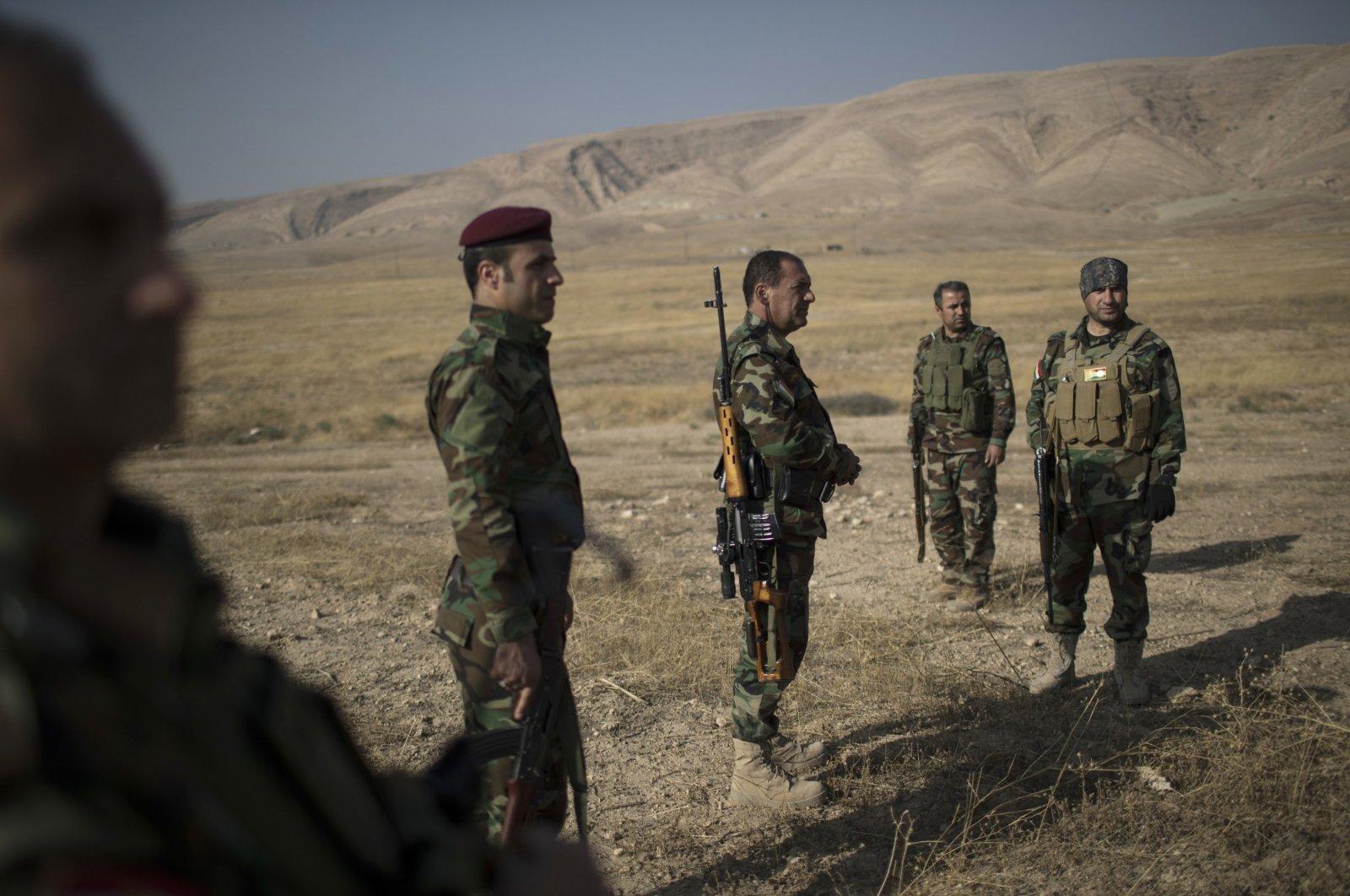 Kurdish Peshmerga fighters gather near a front line in the fight against Daesh terrorists in Bashiqa, east of Mosul, Iraq, Nov. 8, 2016. (AP Photo)