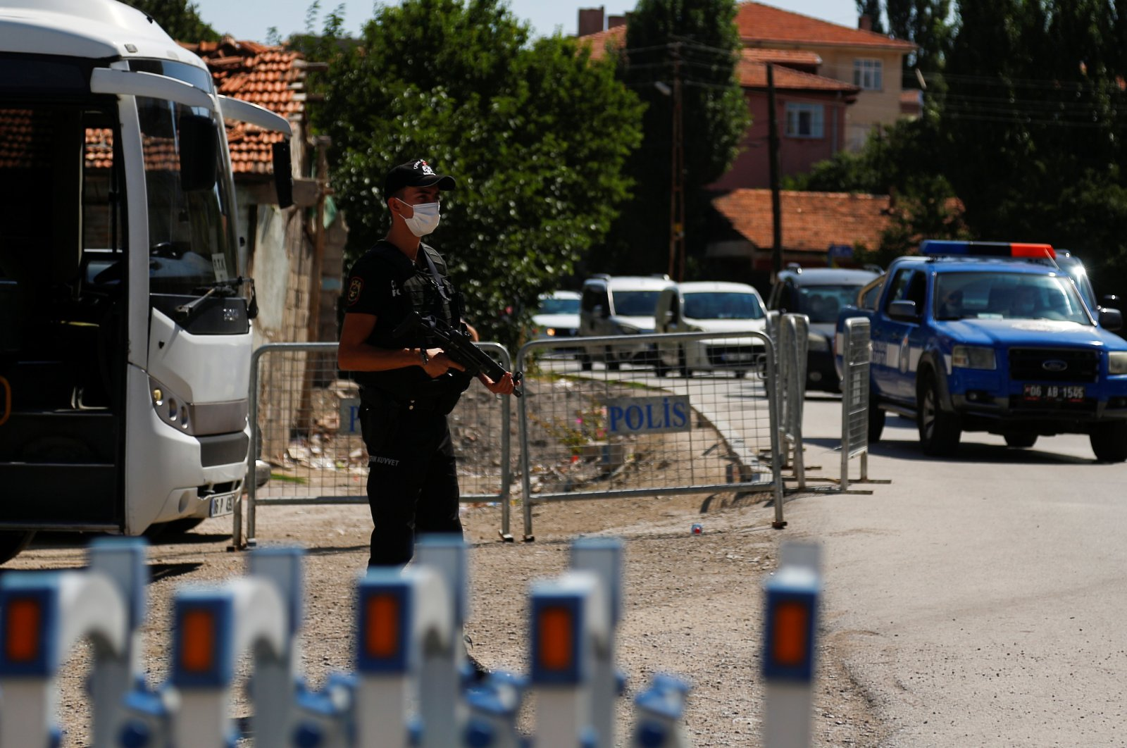 A Turkish riot police member stands guard at a checkpoint on a road which leads to a neighborhood where many Syrian refugees have houses and shops, in Ankara, Turkey, Aug. 12, 2021. (REUTERS Photo)
