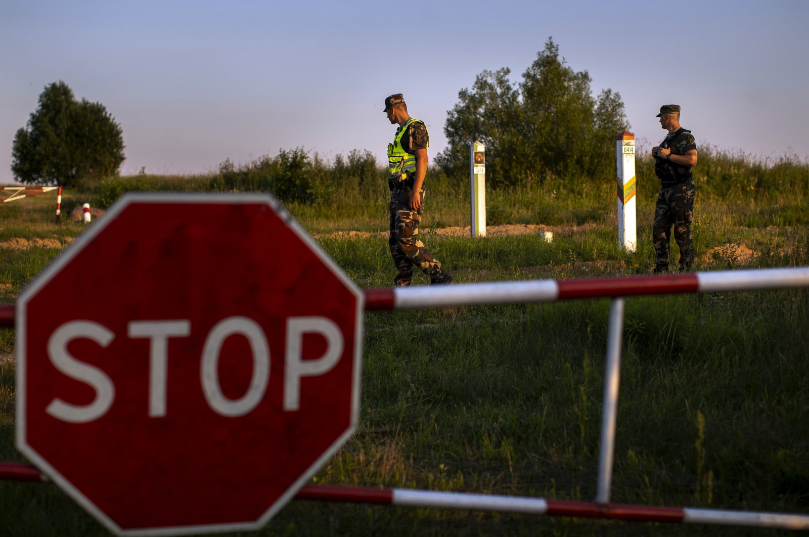Members of the Lithuania State Border Guard Service patrol on the border with Belarus, near the village of Purvenai, Lithuania, July 9, 2021. (AP Photo)