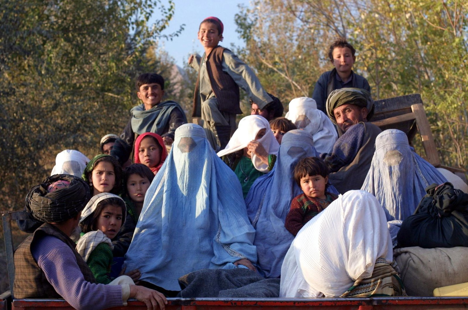 Residents of the northeastern Afghan village of Kalaqata in Takhar province fleeing the frontline area as U.S. fighter planes bomb Taliban positions nearby, Nov. 4, 2001. (AFP Photo)