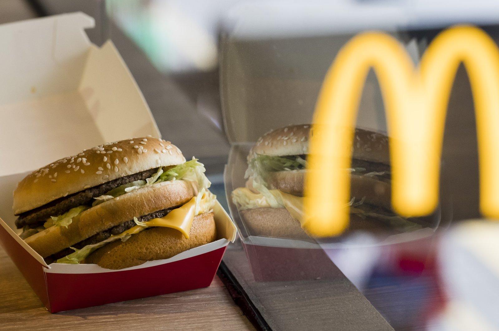 AMcDonald's Big Mac is seen alongside the blurred McDonald's golden arches logo, inHong Kong,Aug. 2, 2018. (Getty Images)