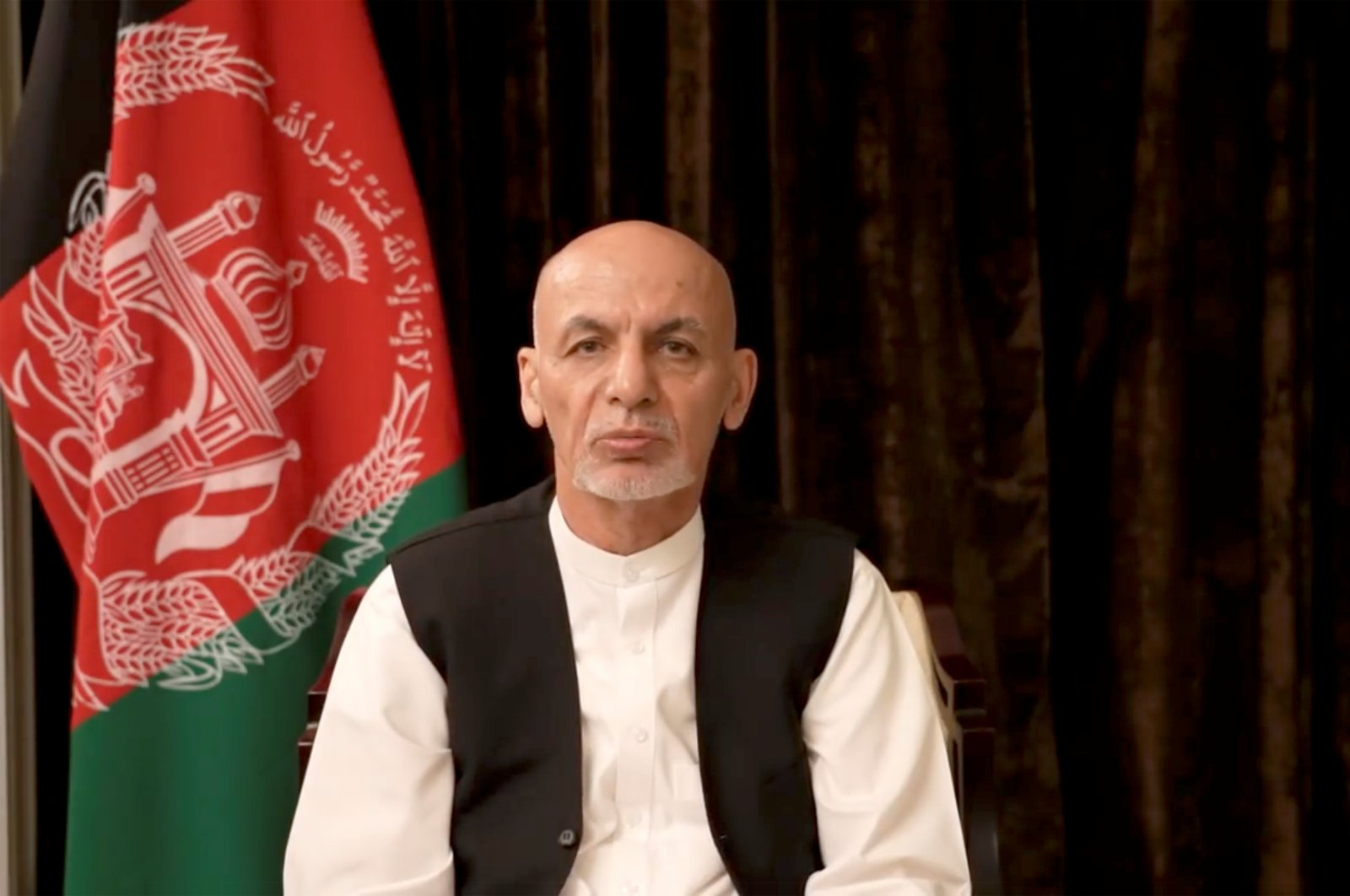 In this screengrab obtained from social media, former Afghan President Ashraf Ghani makes an address about the latest developments in the country from exile in the United Arab Emirates (UAE), Aug. 18, 2021. (Facebook/Ashraf Ghani via Reuters)