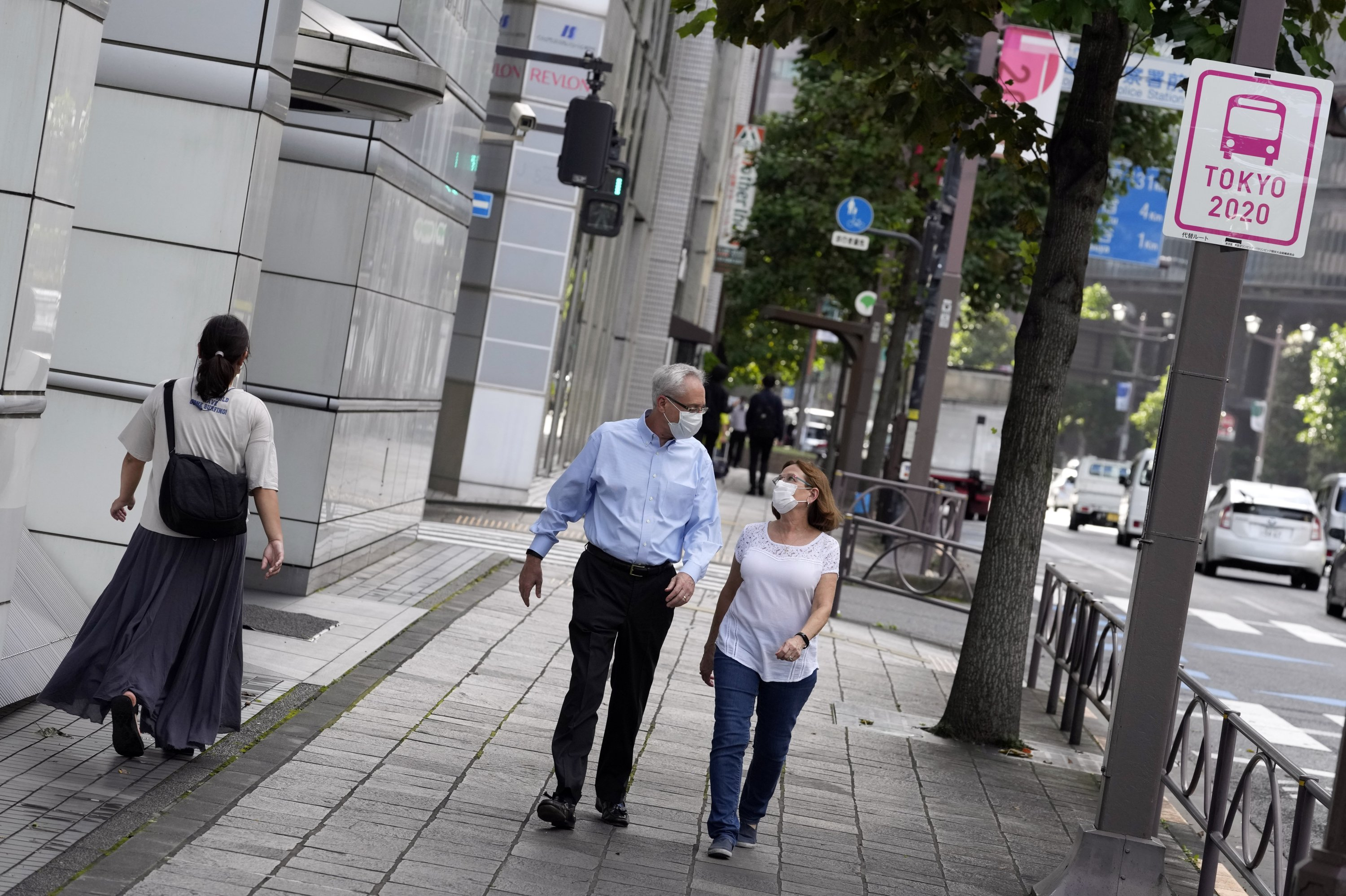 Former Nissan Motor Co. executive Greg Kelly and his wife, Dee Kelly, go for a walk in Tokyo, Japan, Aug. 18, 2021. (AP Photo)