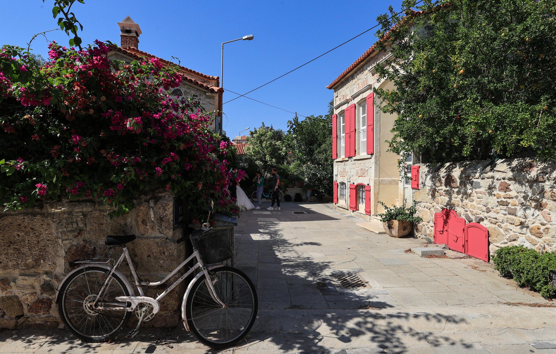 A street view with stone houses in Foça district, Izmir, western Turkey, Aug. 18, 2021. (AA Photo)
