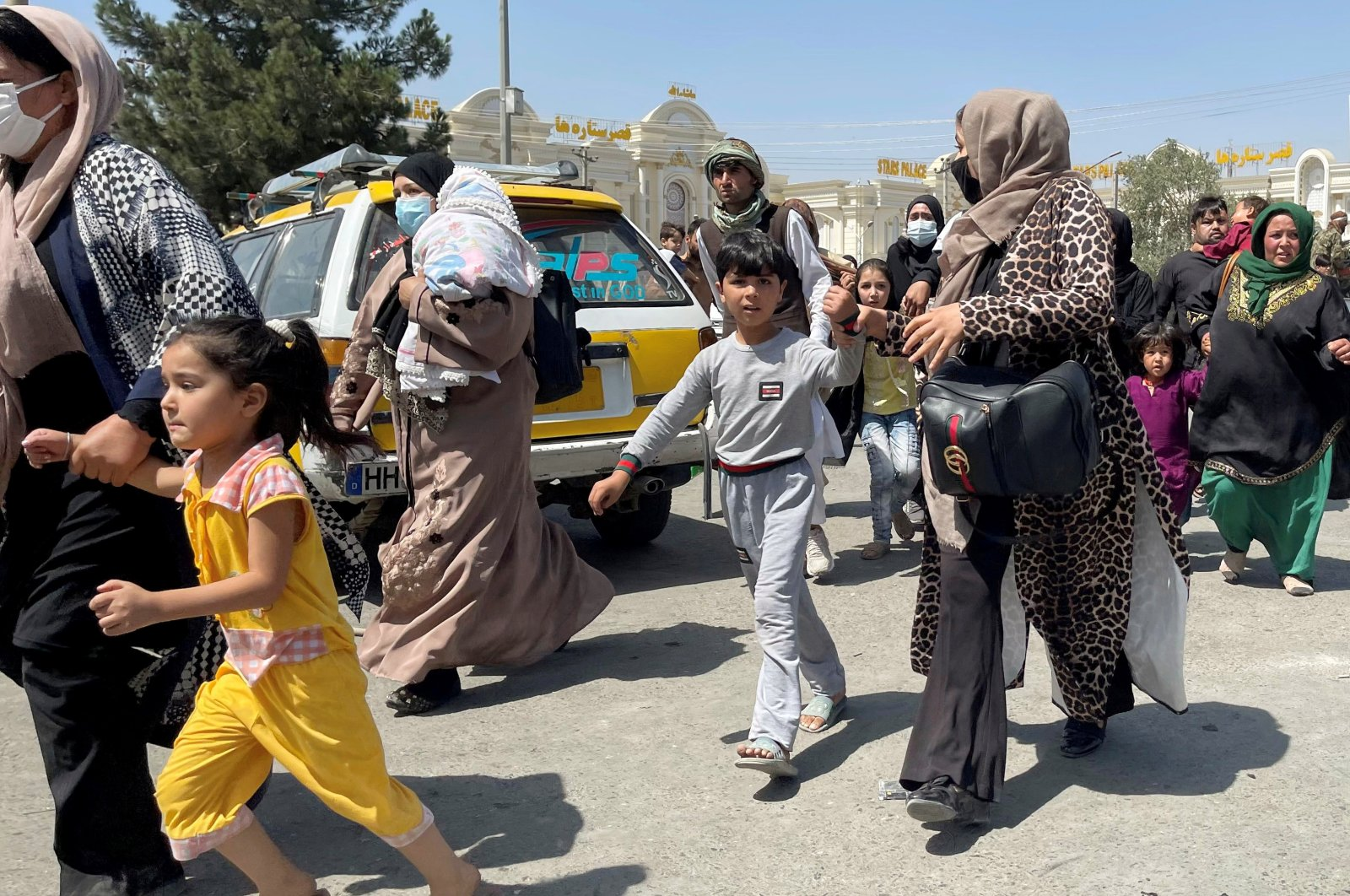Women with their children try to get inside Kabul Hamid Karzai International Airport, Kabul, Afghanistan Aug. 16, 2021. (Reuters Photo)