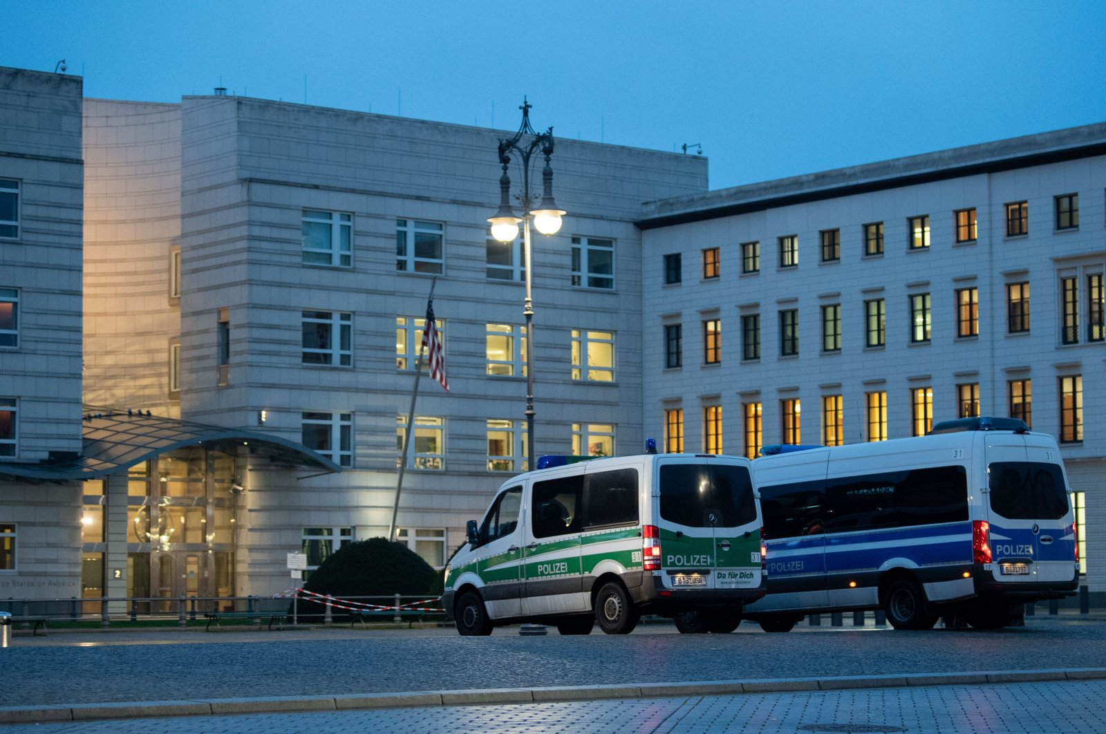 Police vehicles parked outside the U.S. Embassy, in Berlin, Germany, Jan. 7, 2021. (DPA via Getty Images)
