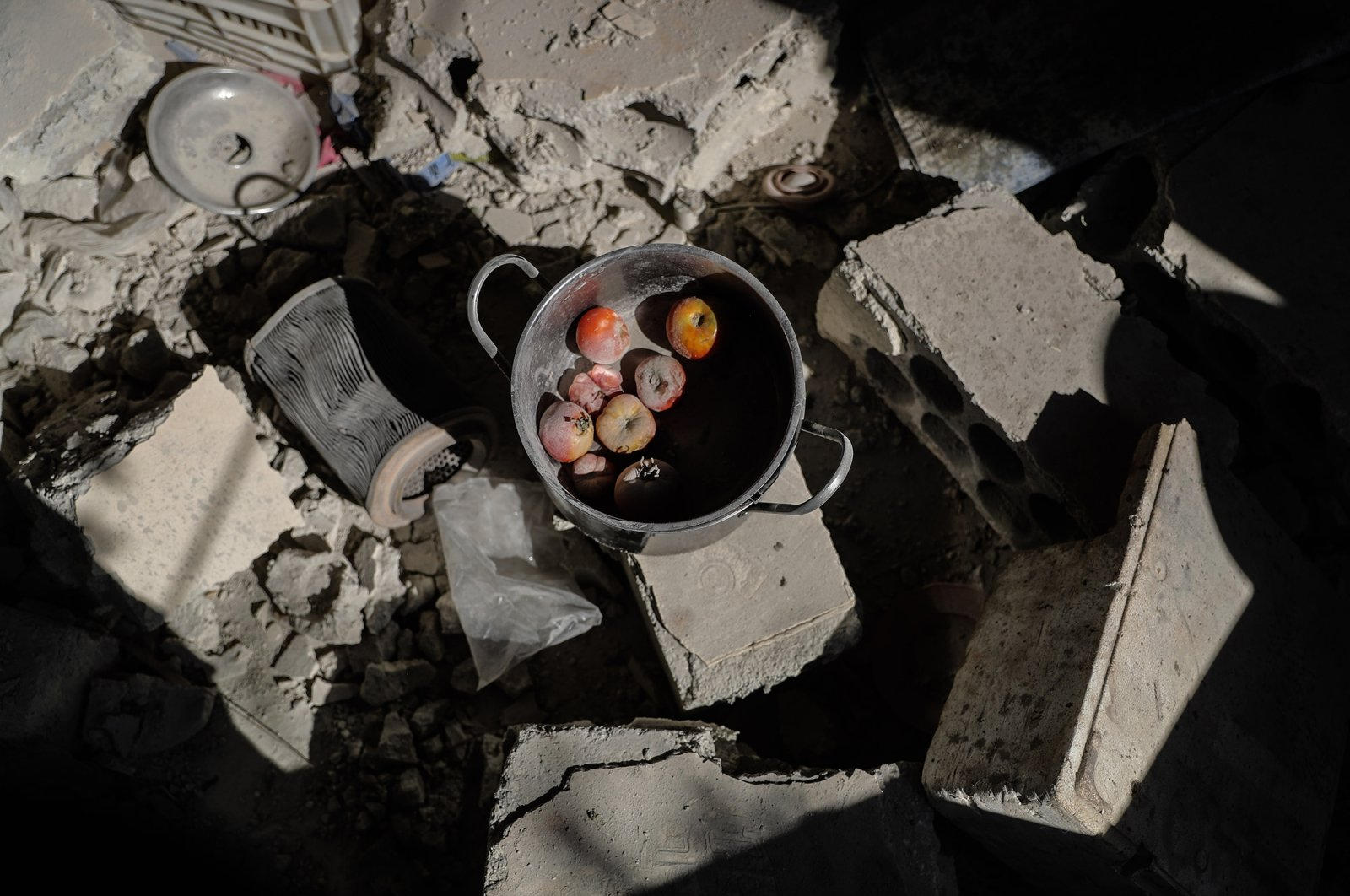 Food remains are seen between the rubble of a residential house that was targeted by a missile shelling carried out by the Syrian regime at the village of Iblin in Idlib,  Syria, July 22, 2021. (Getty Images)