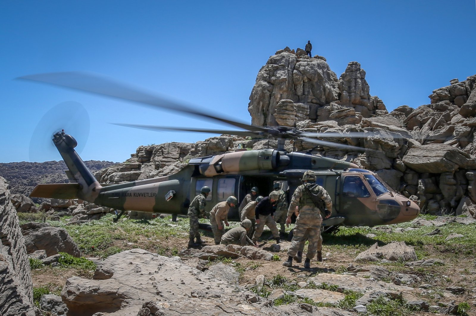 Turkish soldiers board a helicopter to carry out an operation against PKK terrorists at an unidentified location in northern Iraq, June 8, 2018. (AA File Photo)