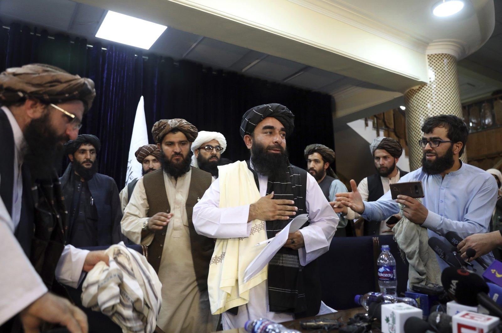 Taliban spokesperson Zabihullah Mujahid (C) leaves after his first news conference, in Kabul, Afghanistan, Aug. 17, 2021. (AP Photo)