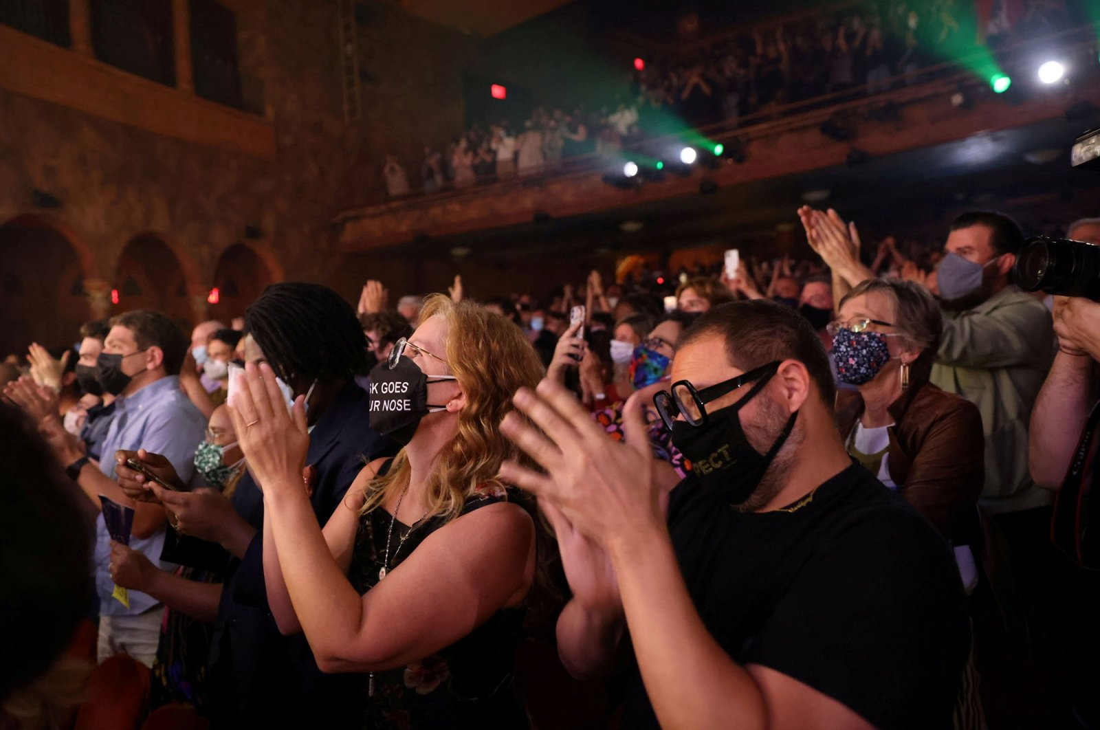 """The audience gives a standing ovation after watching the opening night of previews for """"Pass Over,"""" following the 17-month shutdown of Broadway due to COVID-19, at the August Wilson Theater in New York City, U.S., Aug. 4, 2021. (Reuters Photo)"""