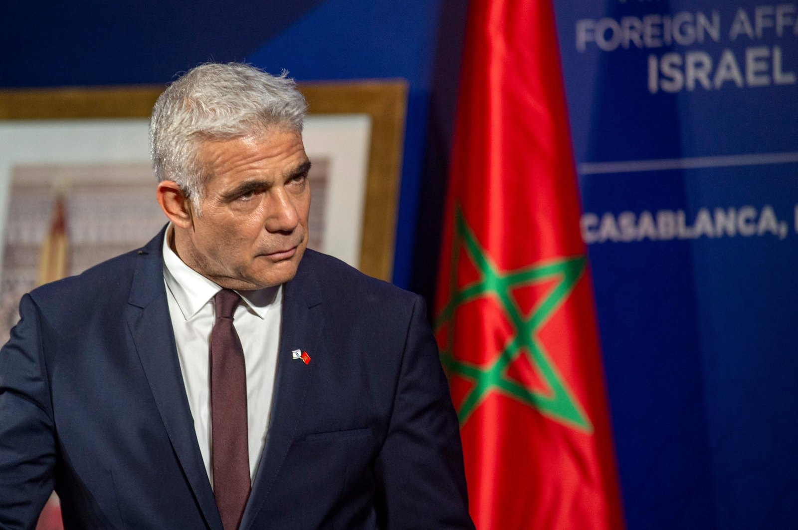 Israeli alternate Prime Minister and Foreign Minister Yair Lapid gives a news conference in Casablanca, Morocco, Aug. 12, 2021. (AFP Photo)