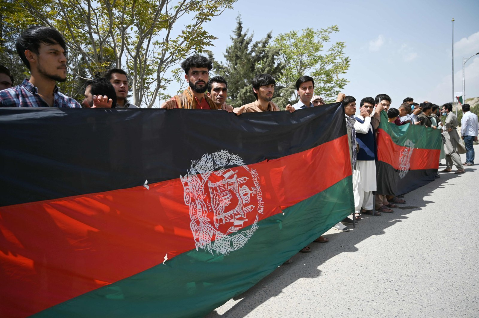 Afghans celebrate the 102nd Independence Day of Afghanistan with the national flag in Kabul, Afghanistan, on Aug. 19, 2021. (AFP Photo)