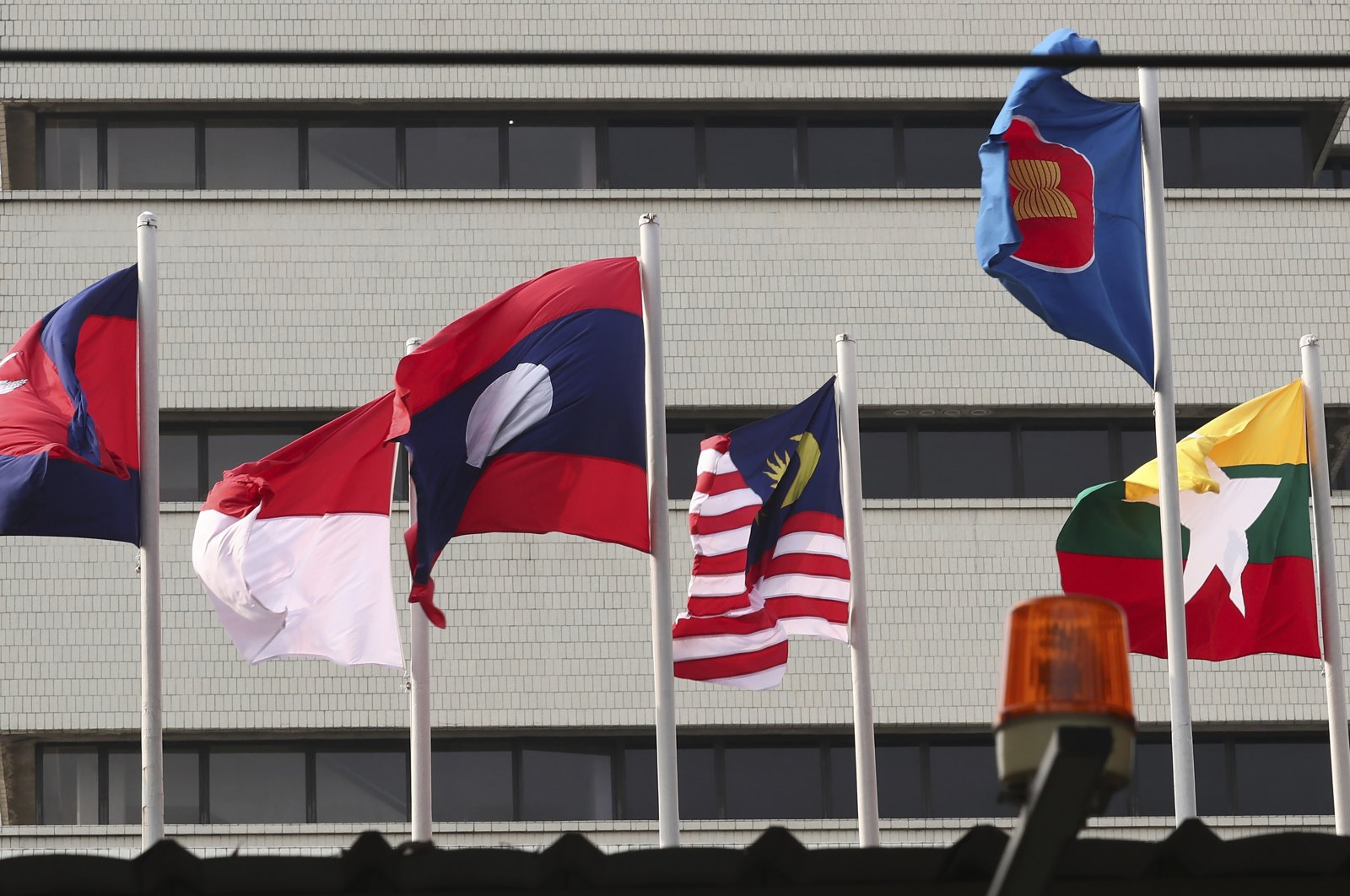 Flags of some of the ASEAN member countries fly at the ASEAN Secretariat in Jakarta, Indonesia, April 22, 2021.  (AP Photo/Tatan Syuflana)